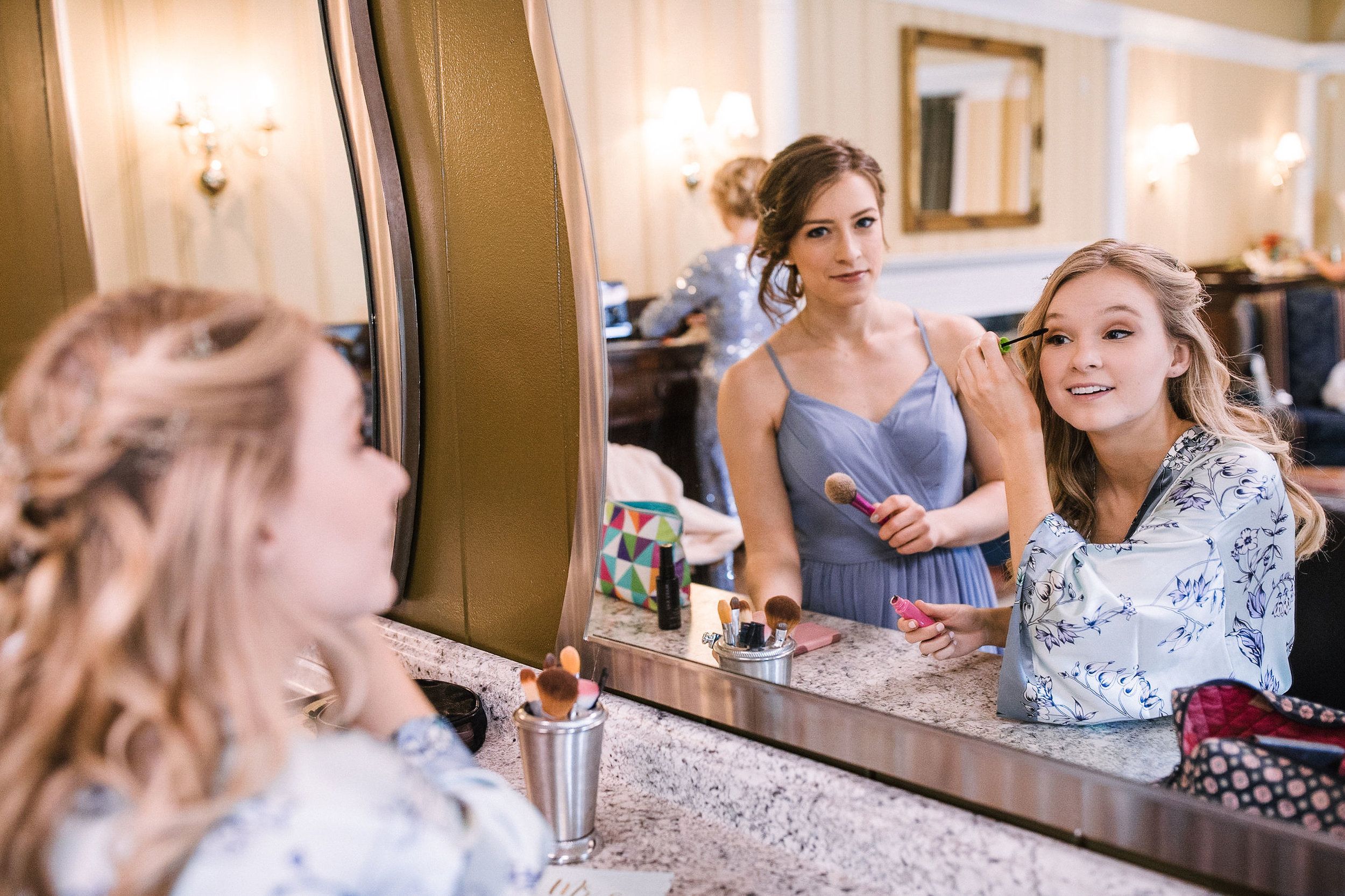 Bride and bridesmaid getting ready at the Inn at the Old Silk Mill