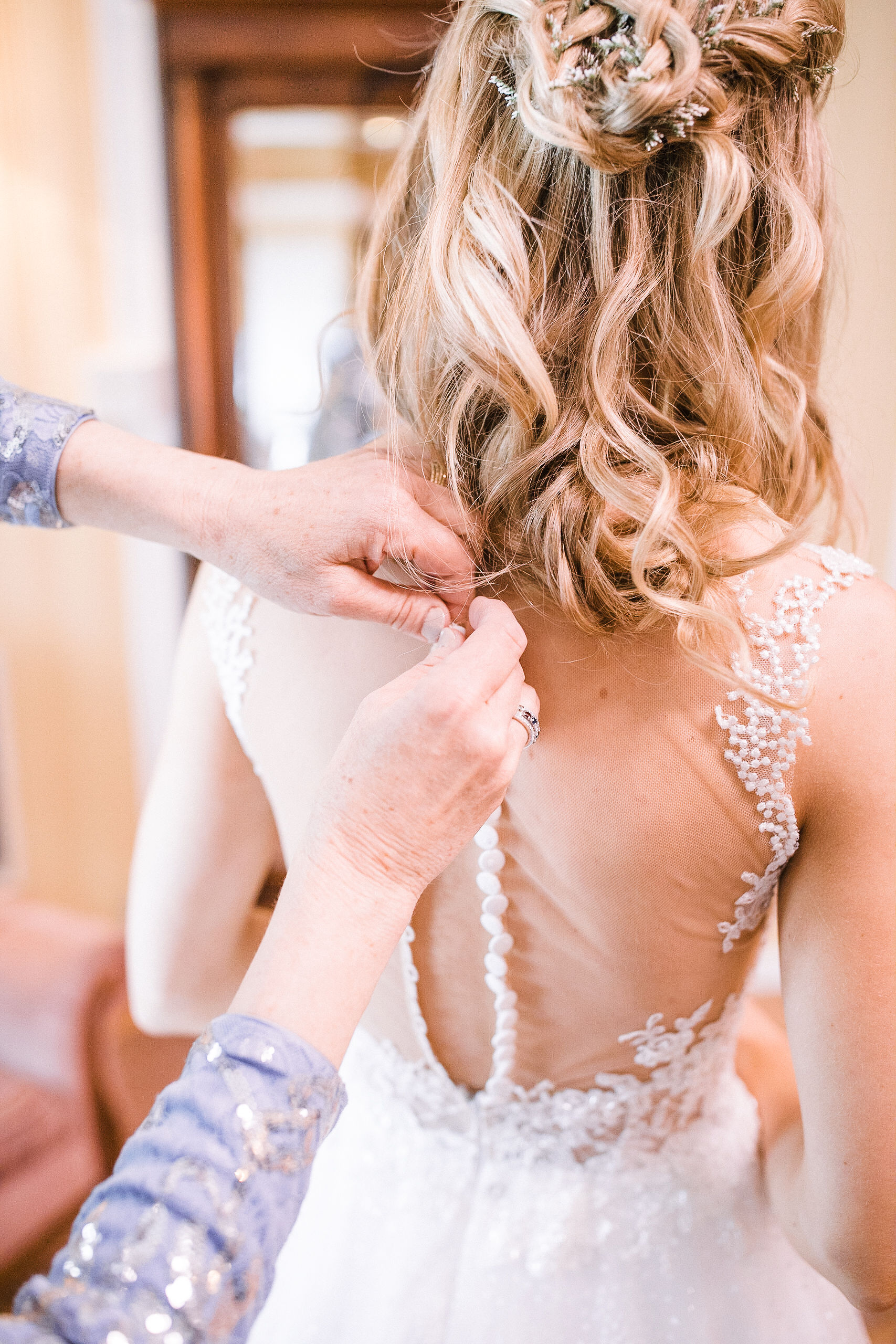 bride getting in wedding dress at the Inn at the Old Silk Mill