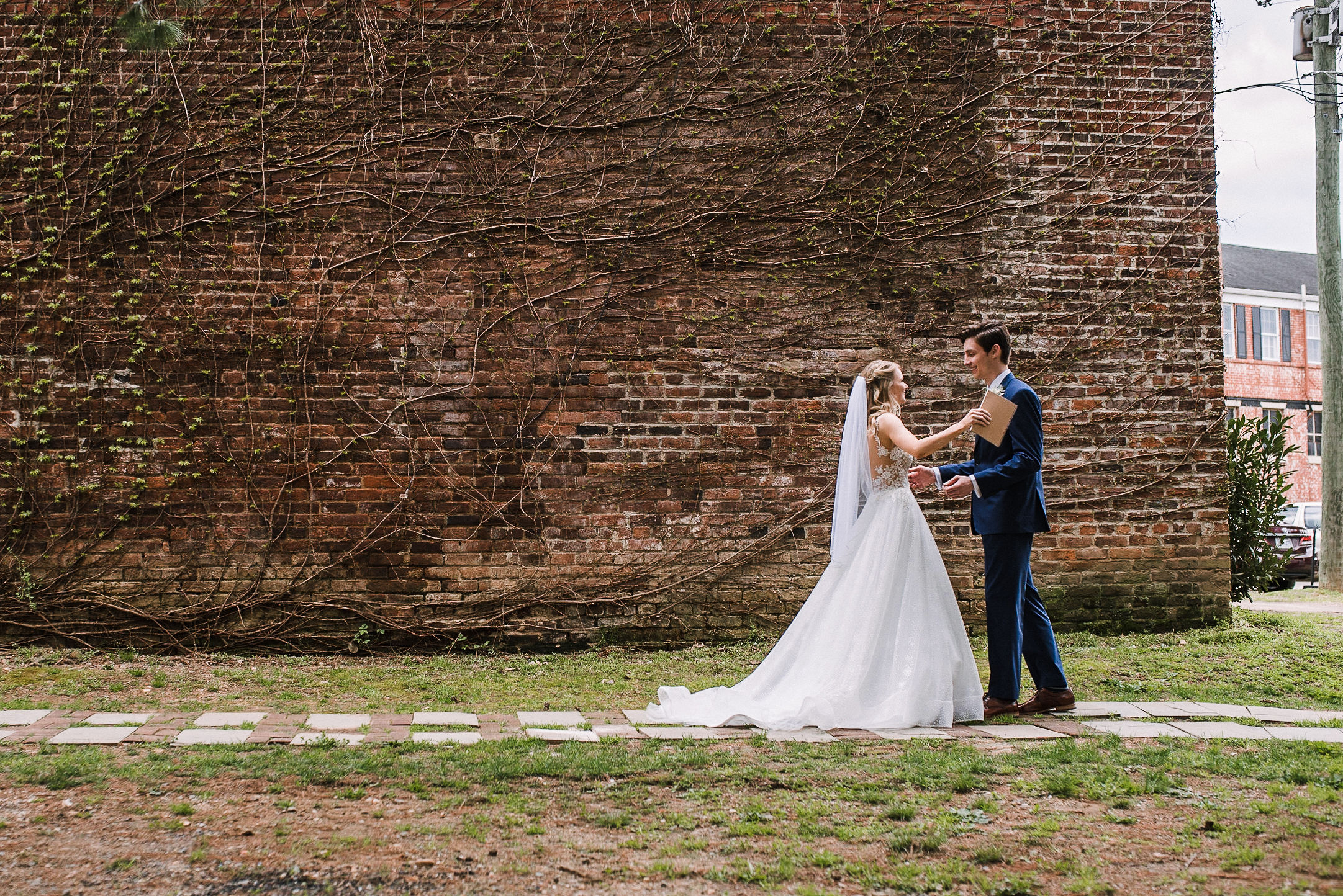 bride and groom doing a first look at the Inn at the Old Silk Mill