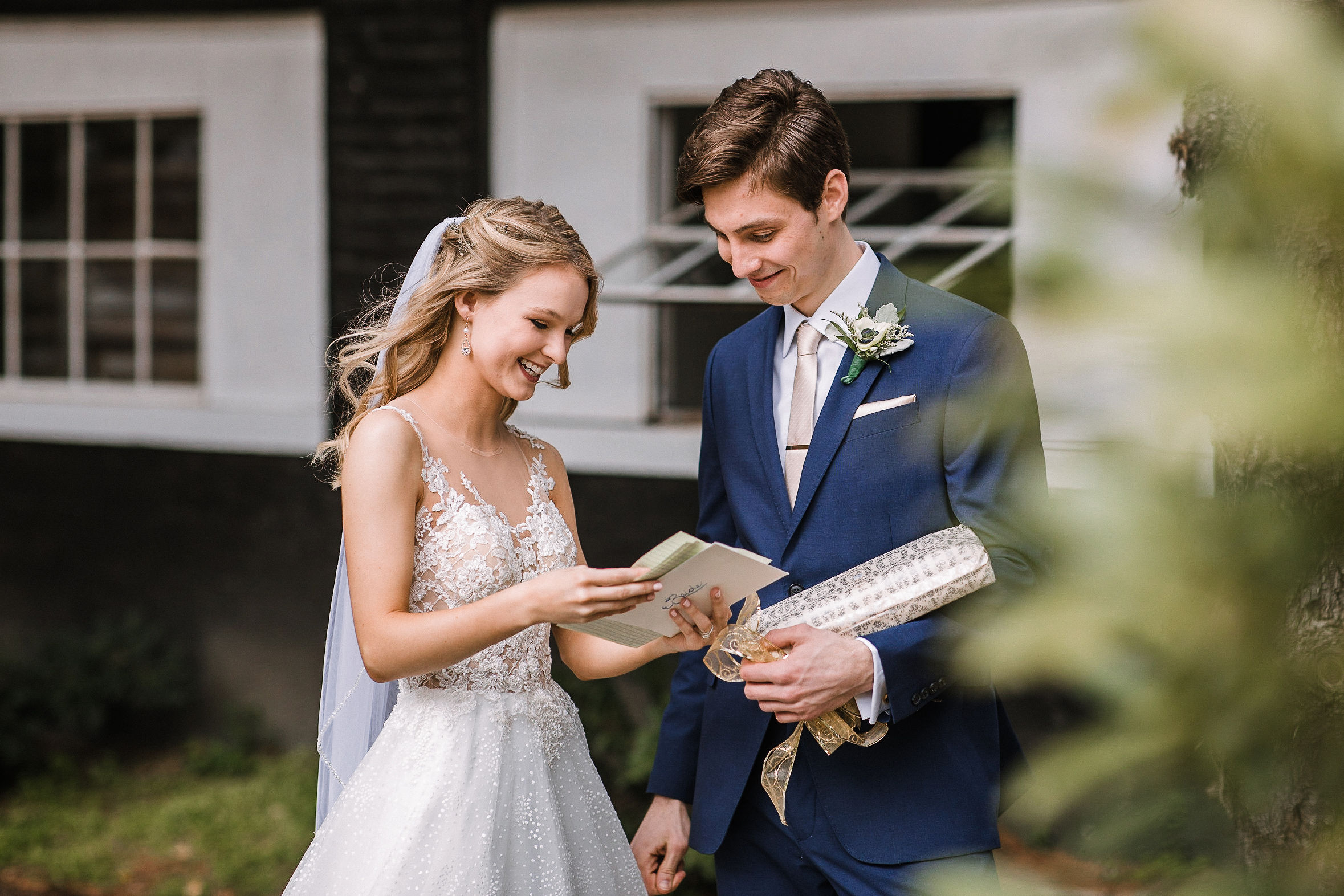 bride and groom sharing gifts at the Inn at the Old Silk Mill