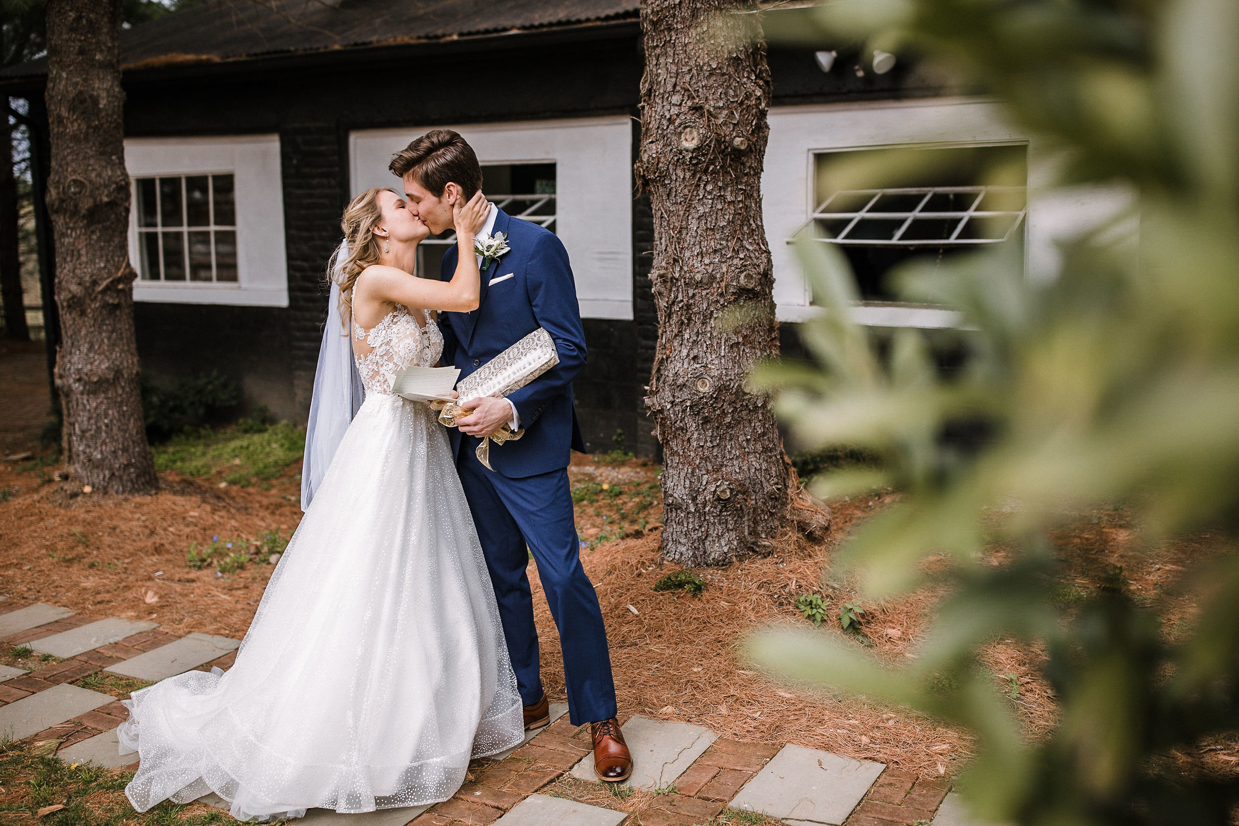 bride and groom kissing at the Inn at the Old Silk Mill