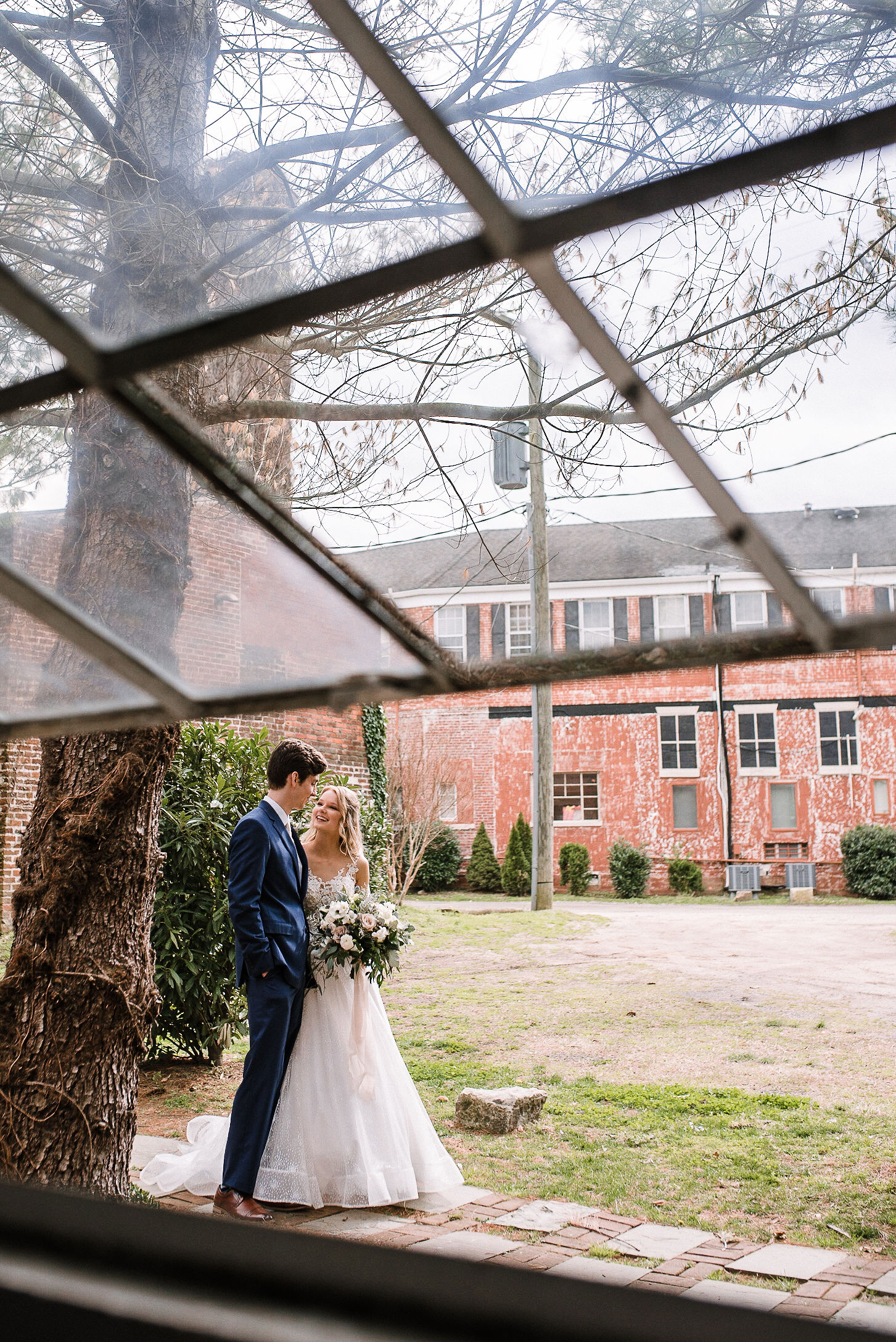 bride and groom embracing at the Inn at the Old Silk Mill