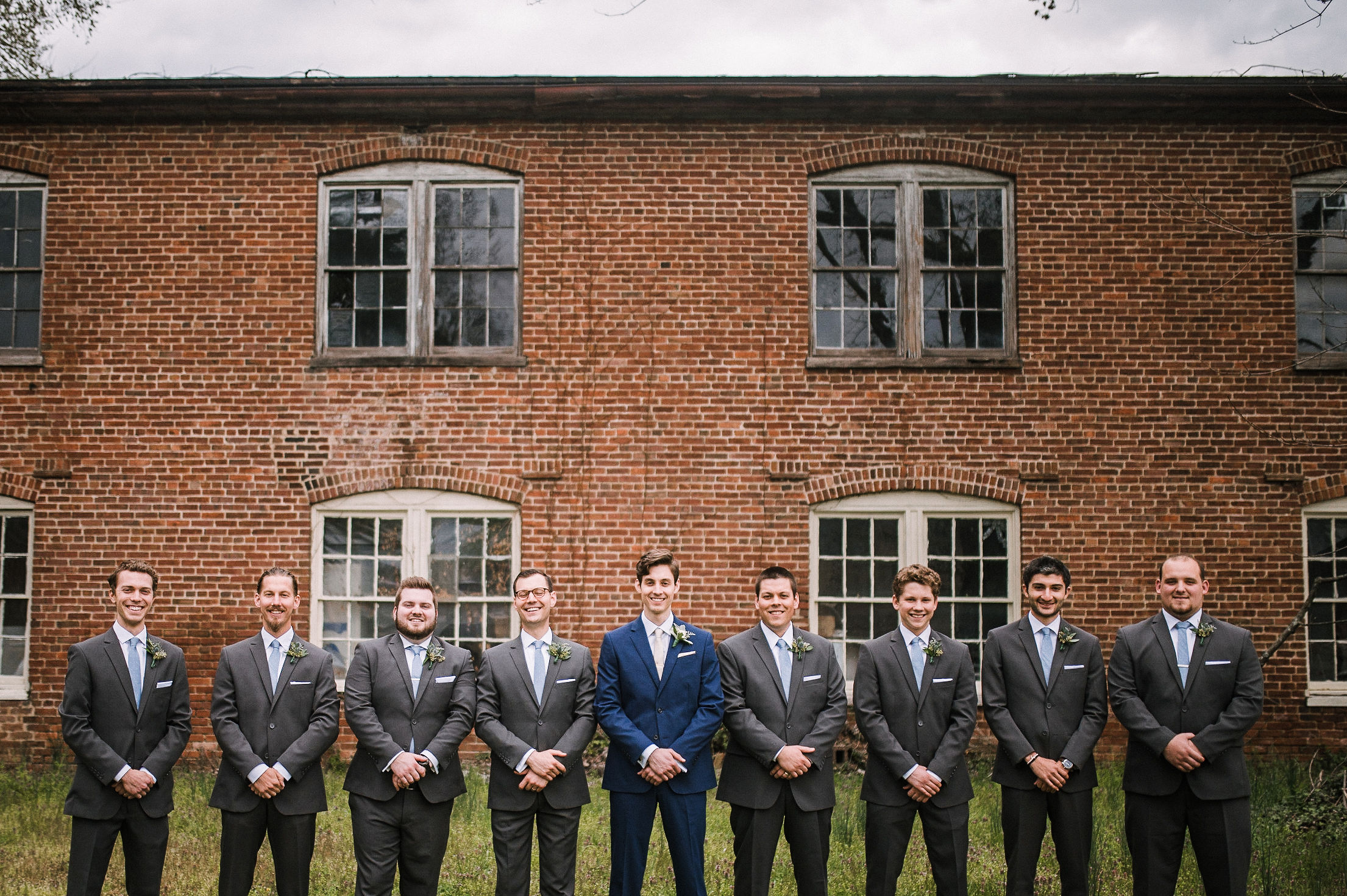 groom and groomsmen posing at the Inn at the Old Silk Mill