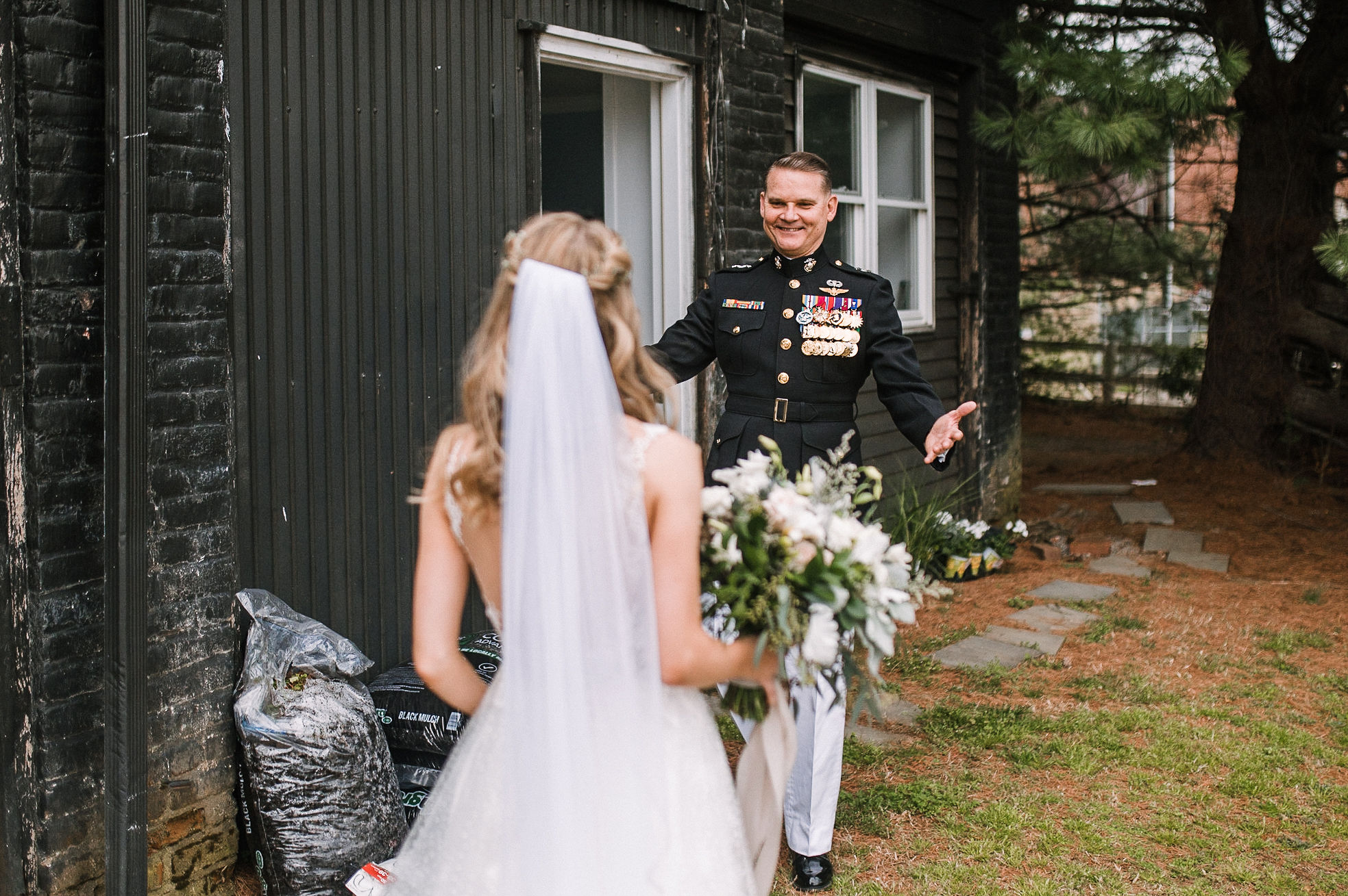 bride does first look with father at the Inn at the Old Silk Mill