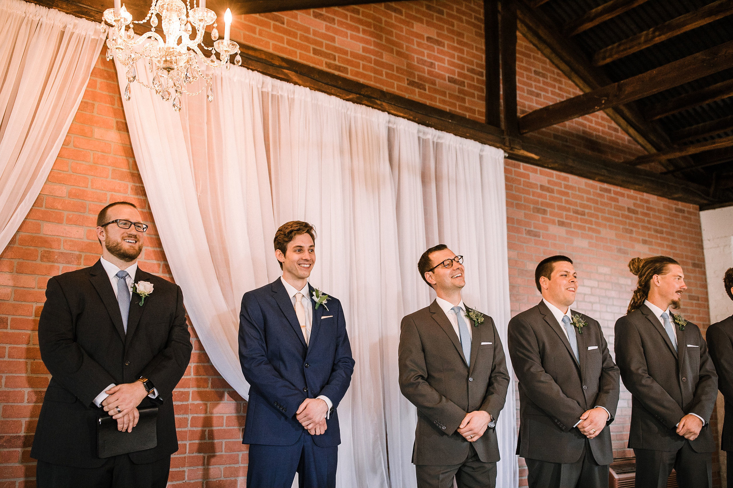 groom waiting for bride at the Inn at the Old Silk Mill