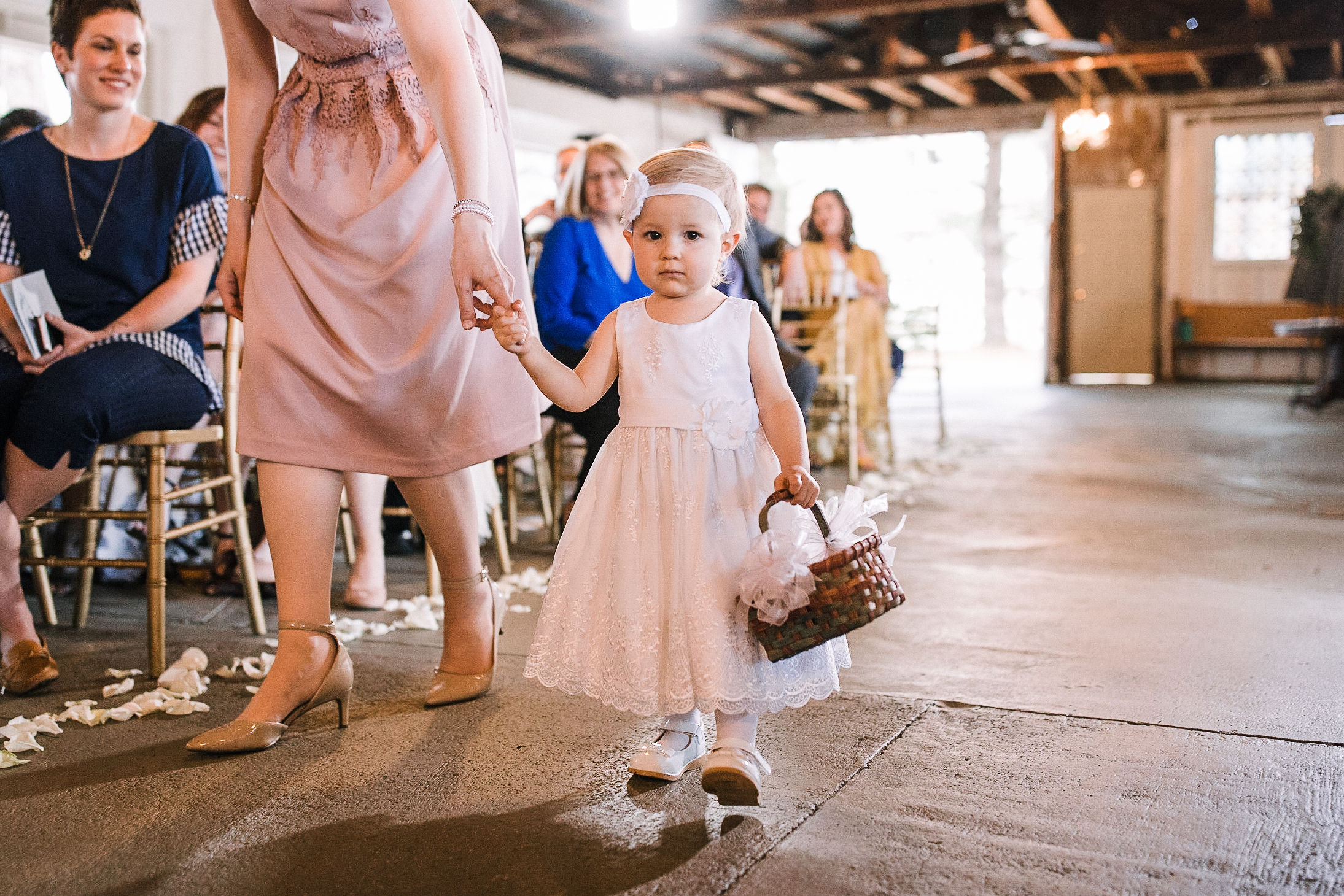 flower girl walking down aisle at the Inn at the Old Silk Mill