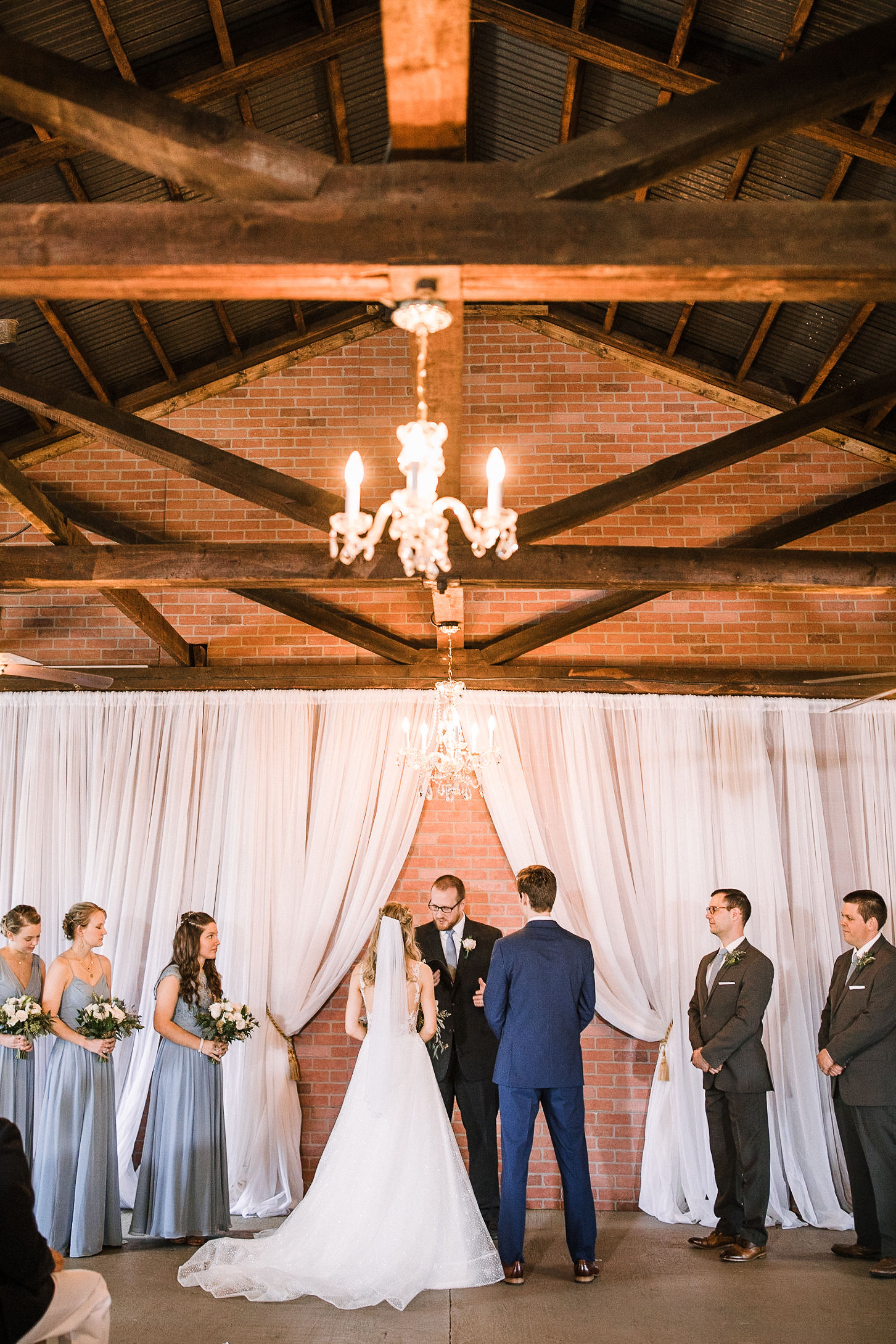 bride and groom at the altar at the Inn at the Old Silk Mill