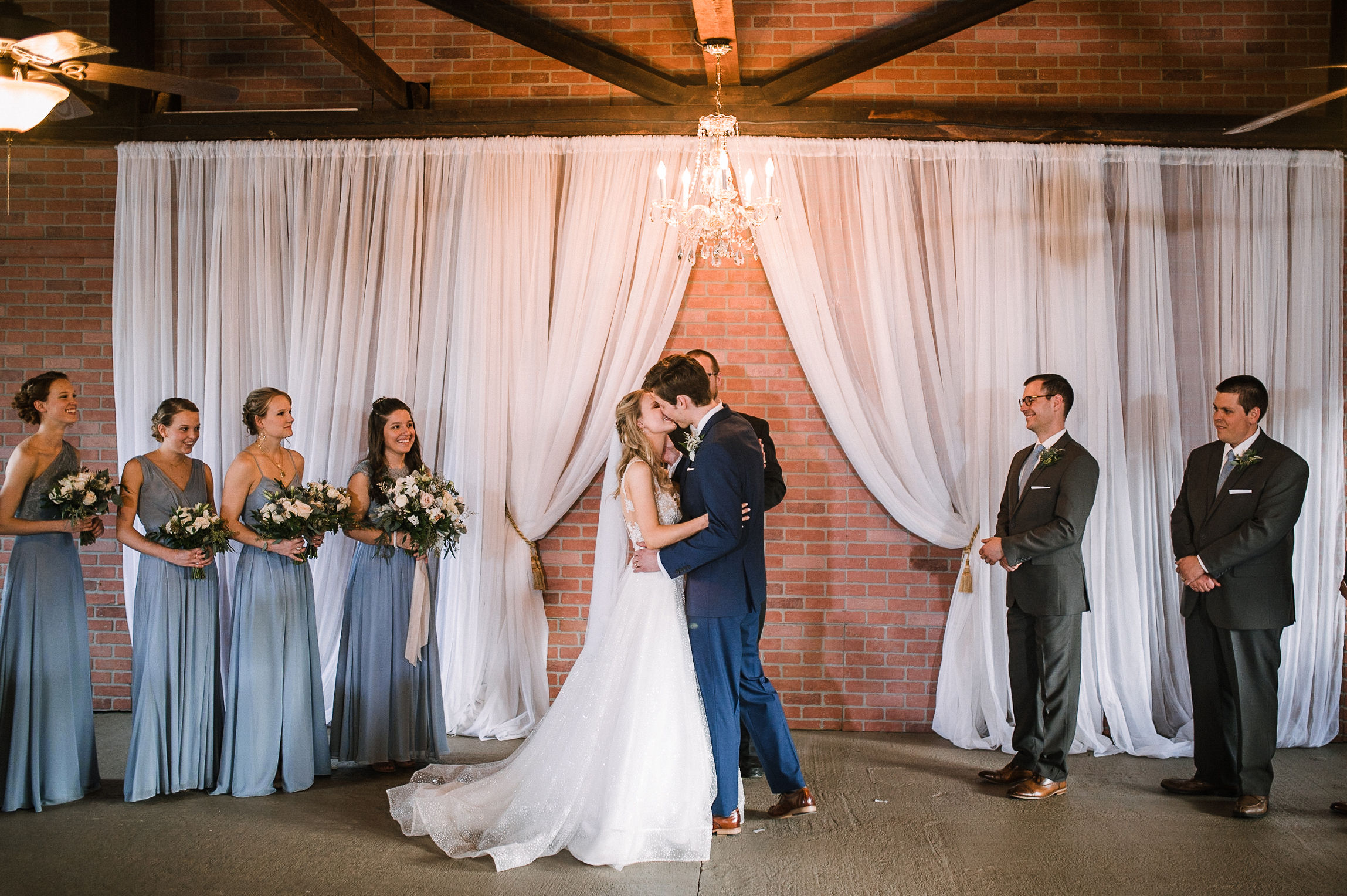 bride and groom kissing at altar at the Inn at the Old Silk Mill