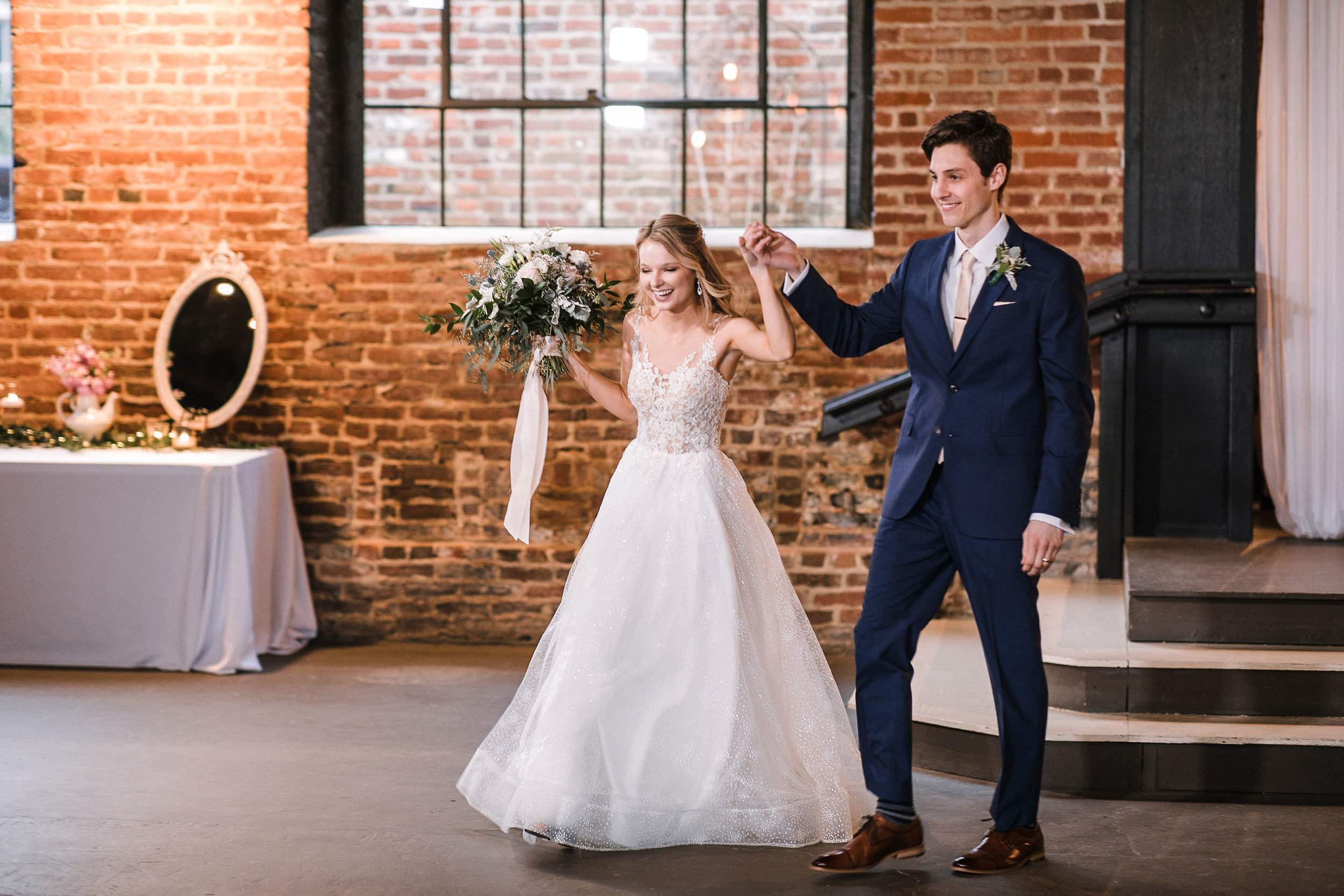 bride and groom entering reception at the Inn at the Old Silk Mill