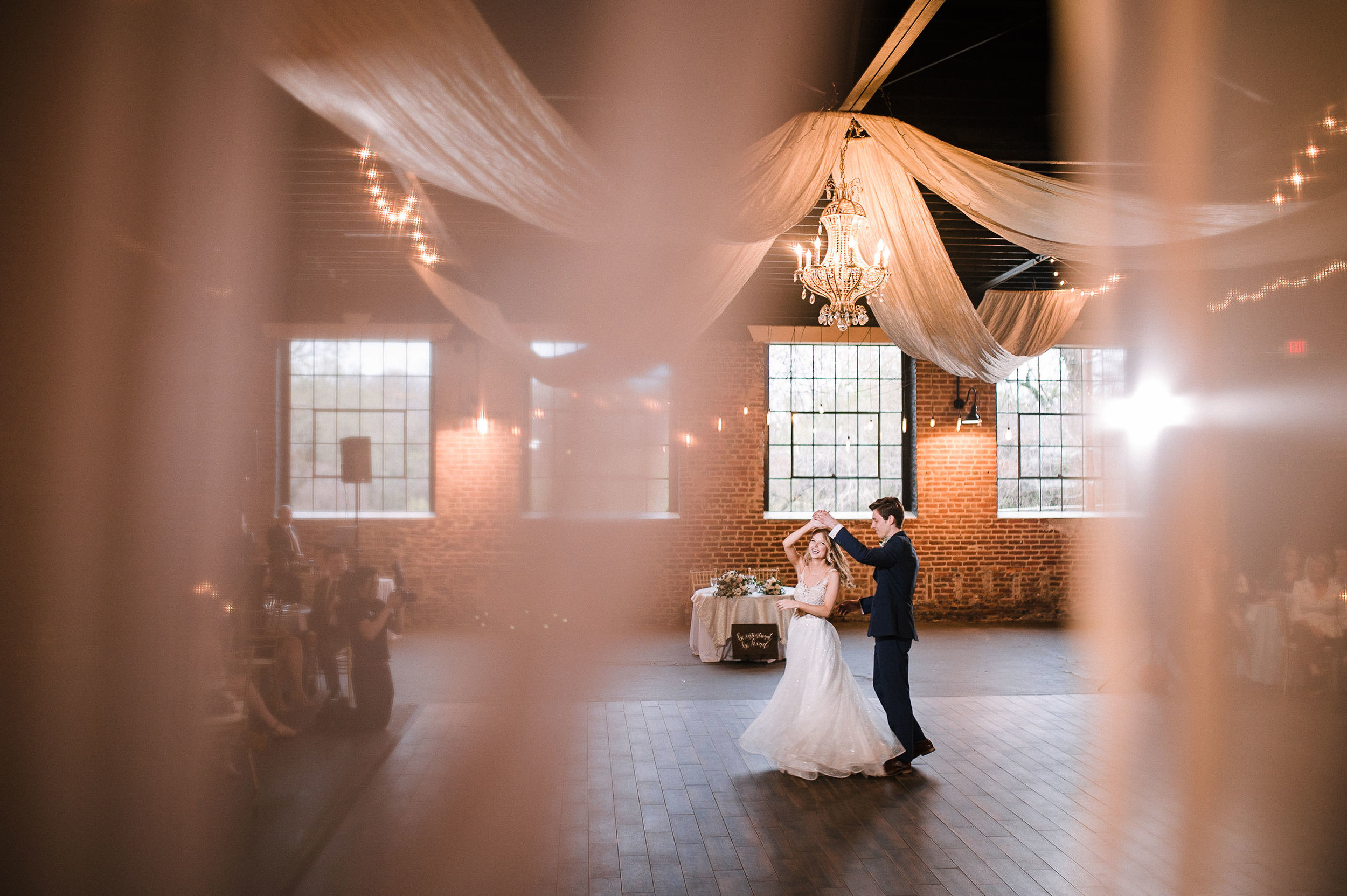 bride and groom having first dance at the Inn at the Old Silk Mill