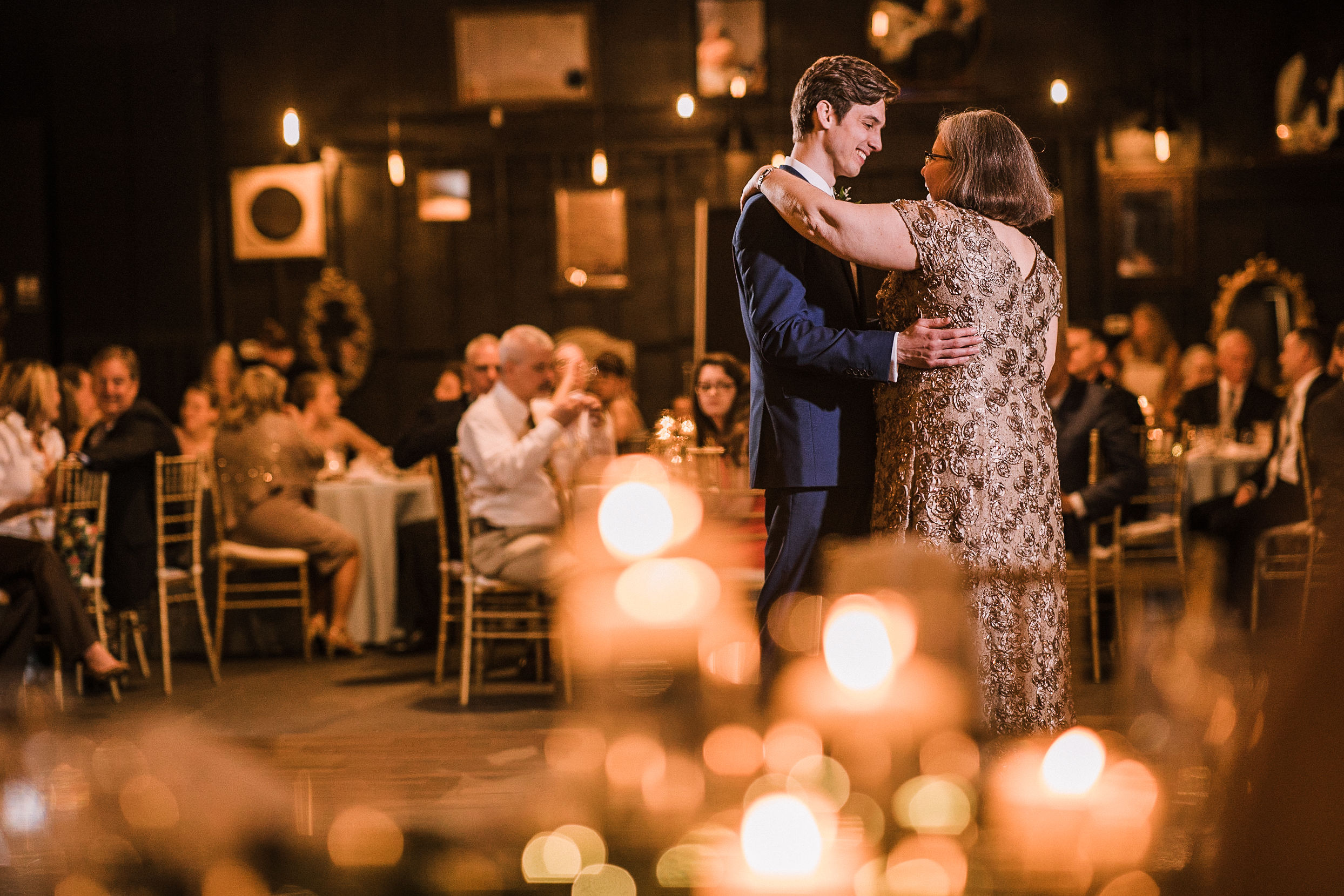 groom dancing with mother at the Inn at the Old Silk Mill