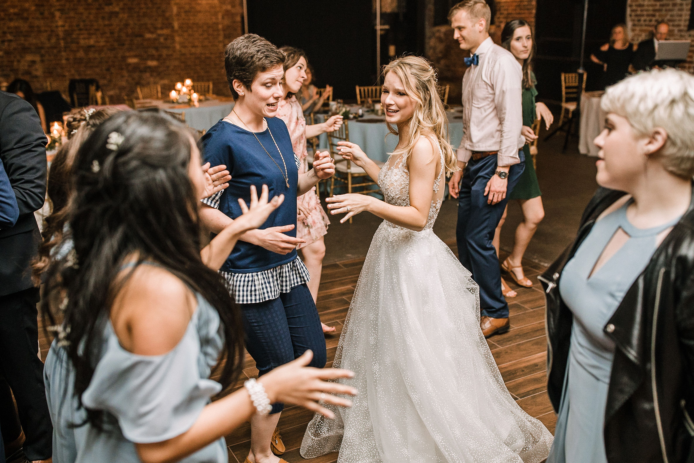 bride dancing with guests at the Inn at the Old Silk Mill