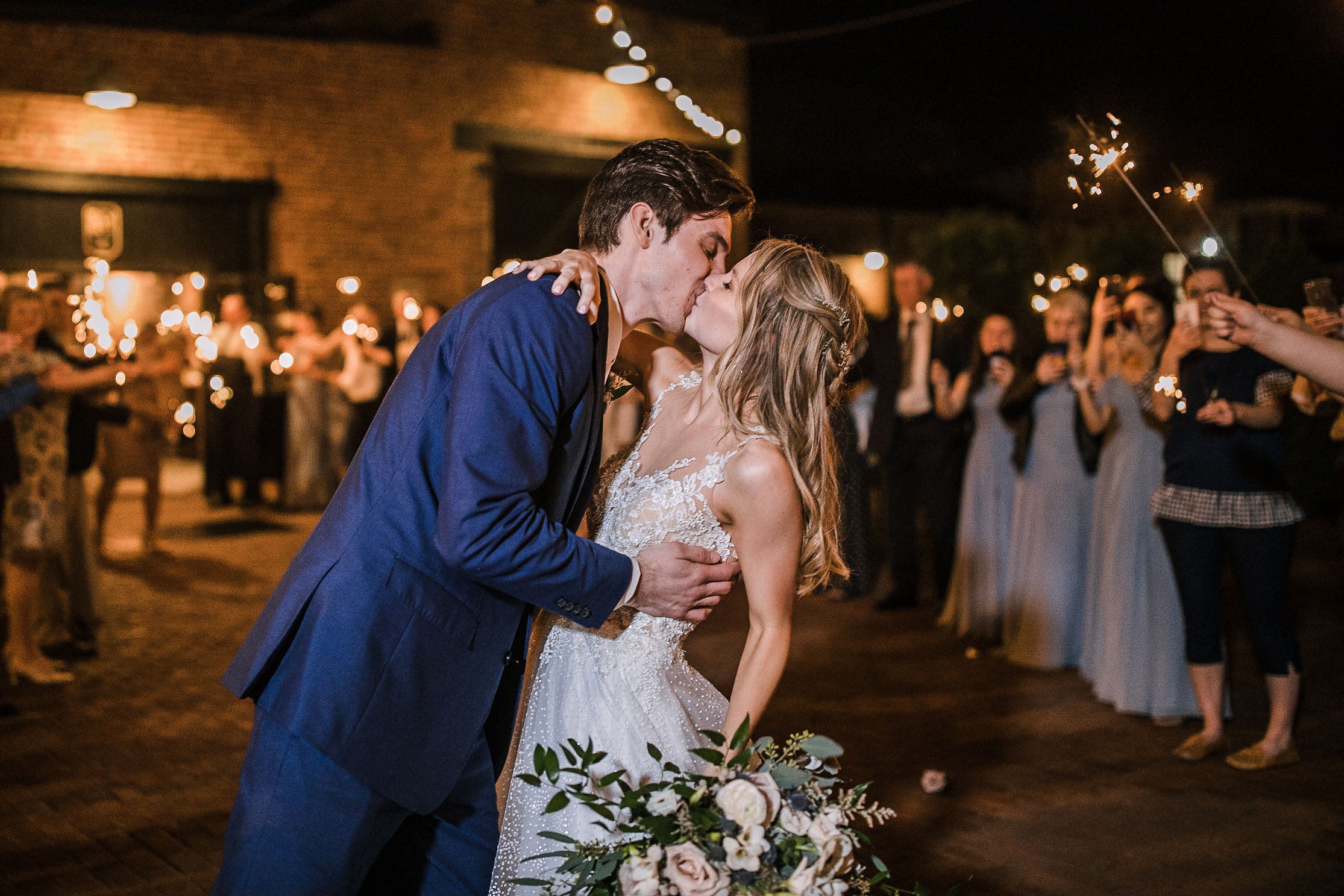 bride and groom kissing under sparklers at the Inn at the Old Silk Mill