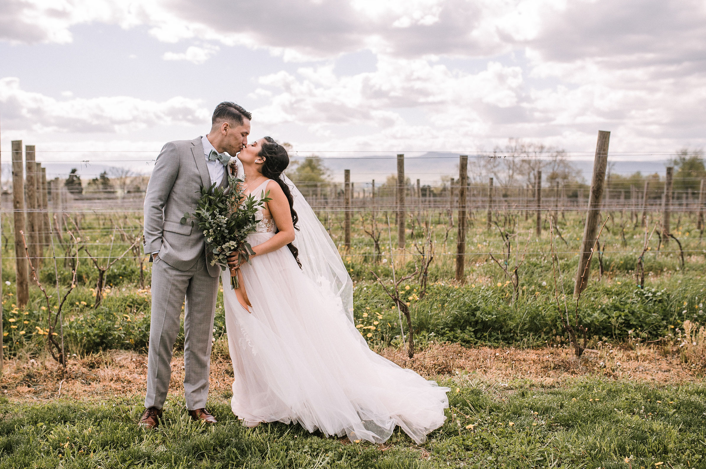 bride and groom kissing at the Faithbrooke Barn & Vineyards