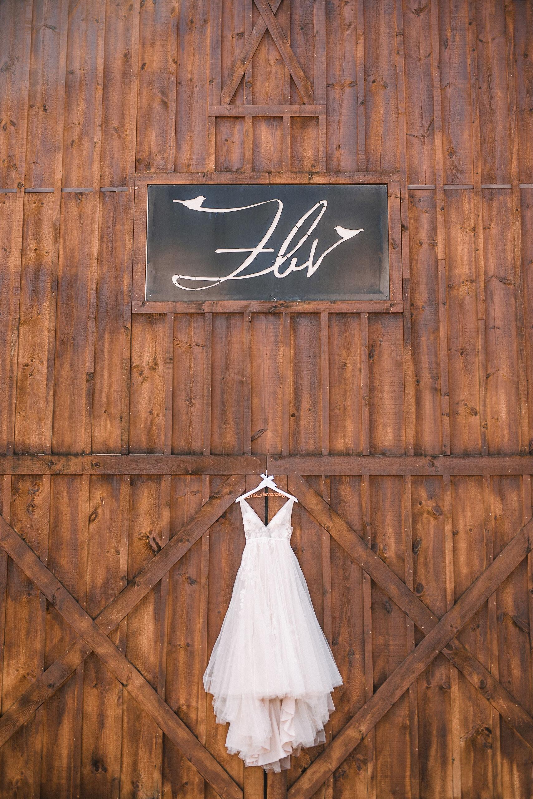 detail shot of wedding dress at the Faithbrooke Barn & Vineyards