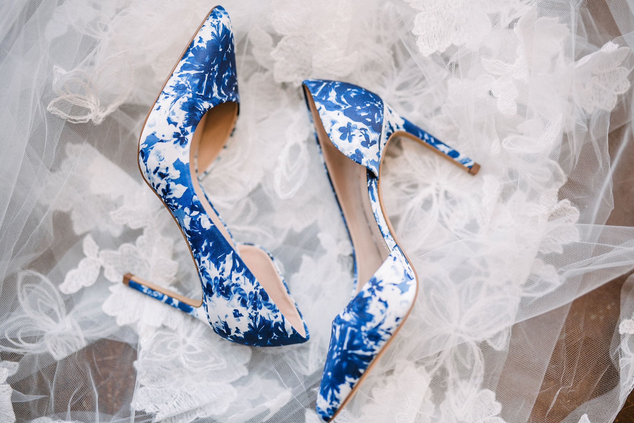 detail shot of bride's wedding shoes at the Faithbrooke Barn & Vineyards