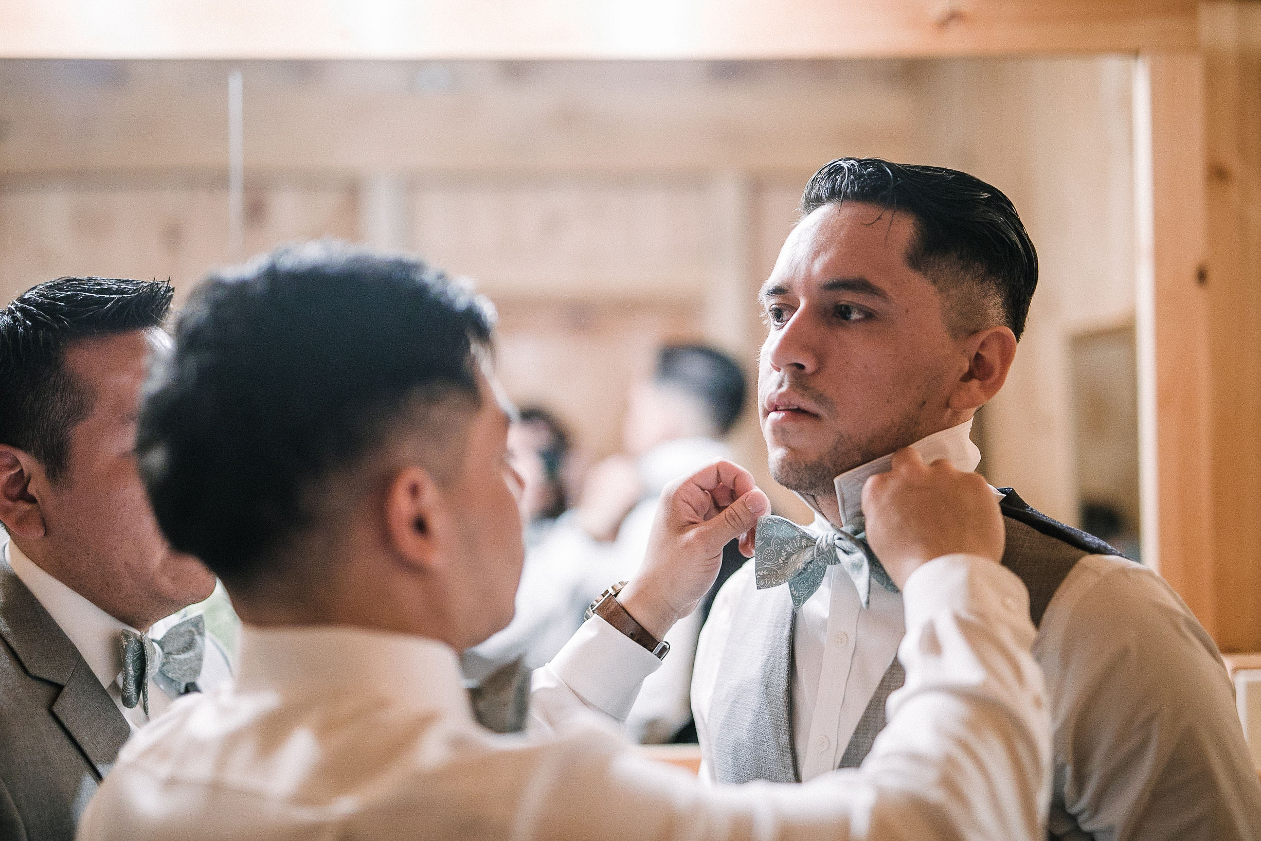 groom getting ready at the Faithbrooke Barn & Vineyards
