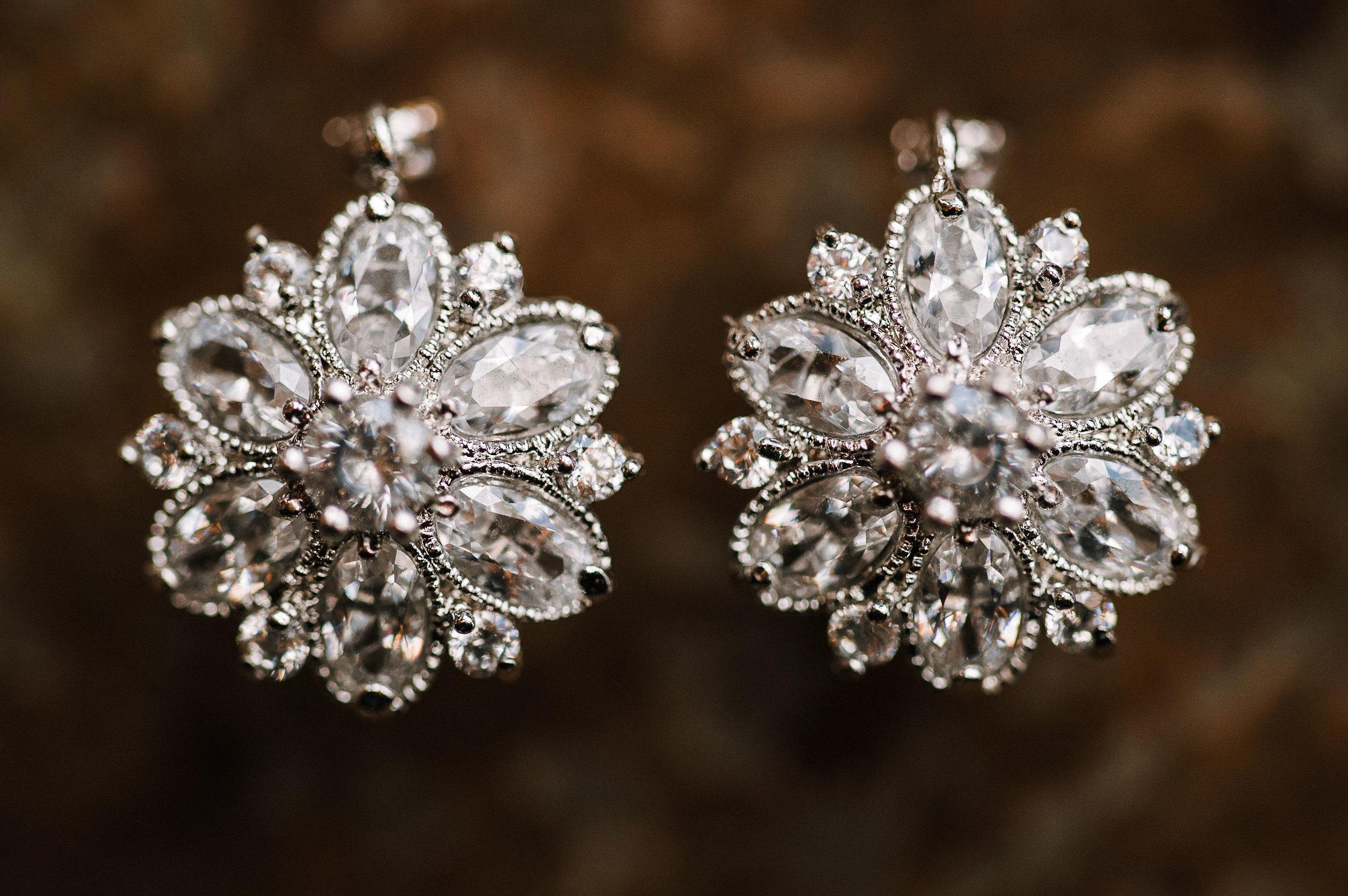 detail shot of bride's earrings at the Faithbrooke Barn & Vineyards