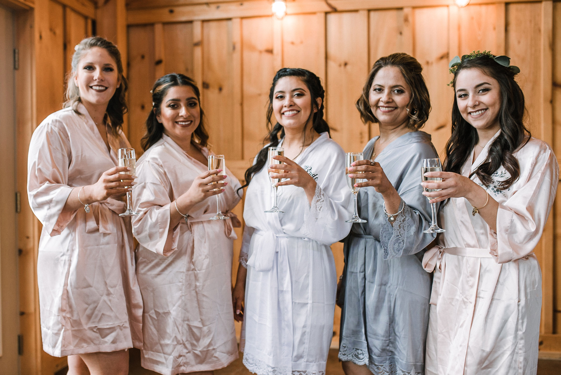 bride and bridesmaids posing with champagne at the Faithbrooke Barn & Vineyards