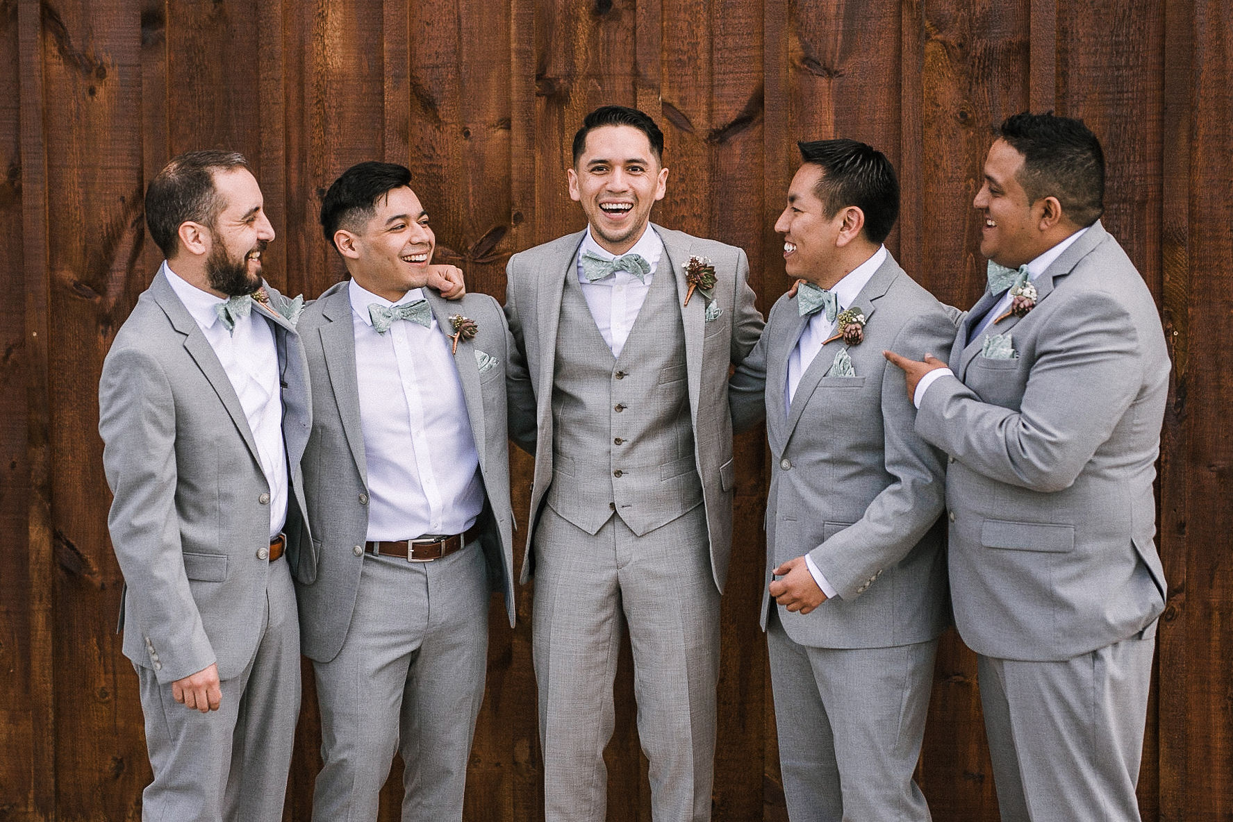 Groom and groomsmen laughing at the Faithbrooke Barn & Vineyards