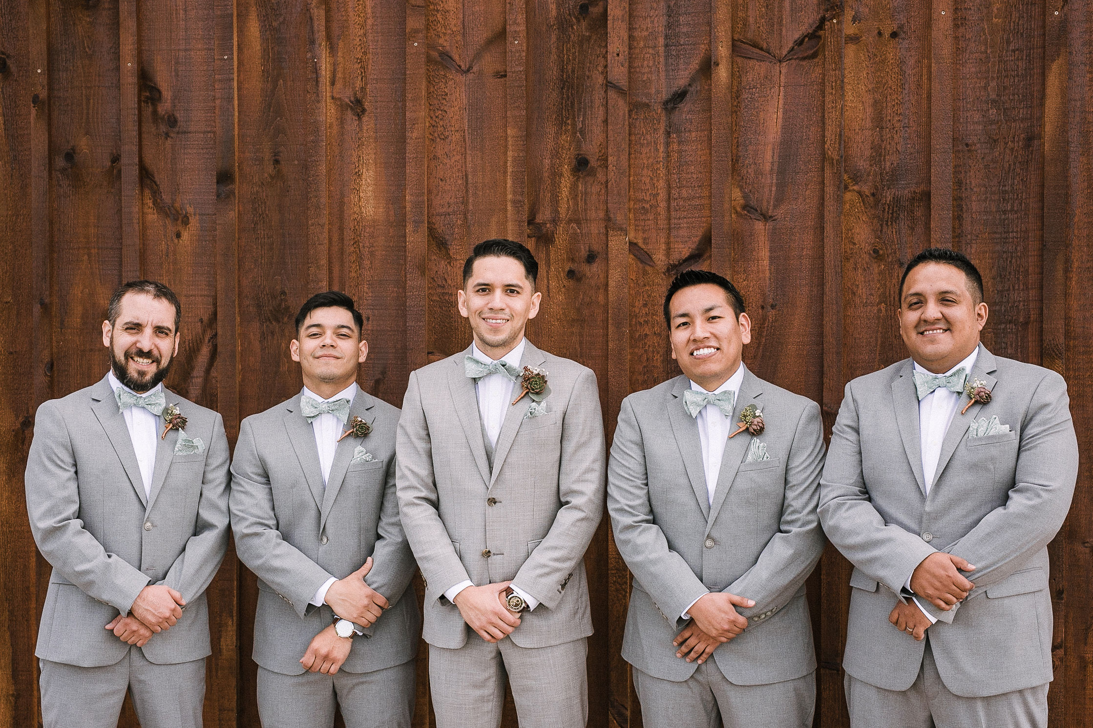 groom and groomsmen smiling and posing at the Faithbrooke Barn & Vineyards