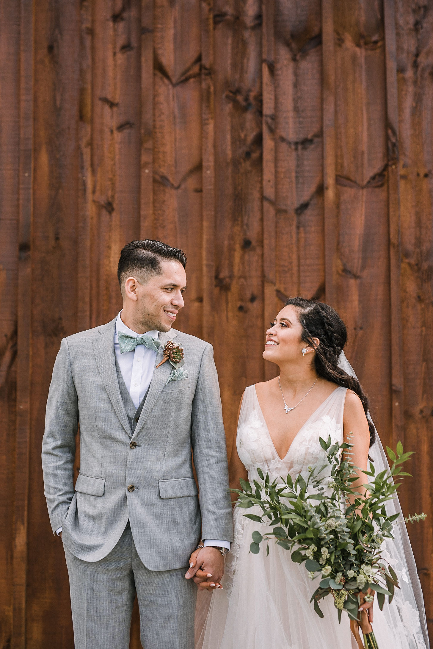 bride and groom looking at each other at the Faithbrooke Barn & Vineyards