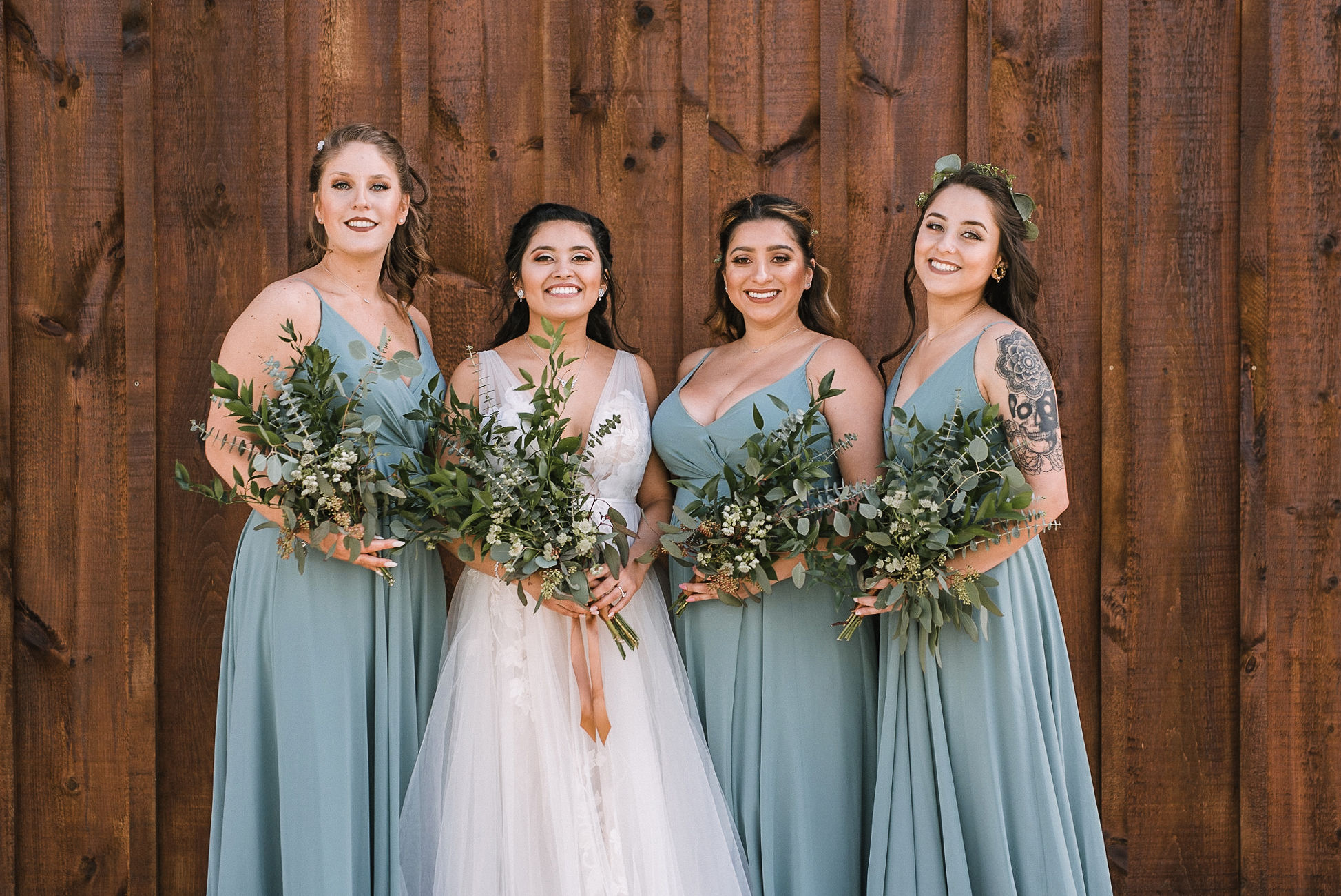 bride and bridesmaids smiling at the Faithbrooke Barn & Vineyards