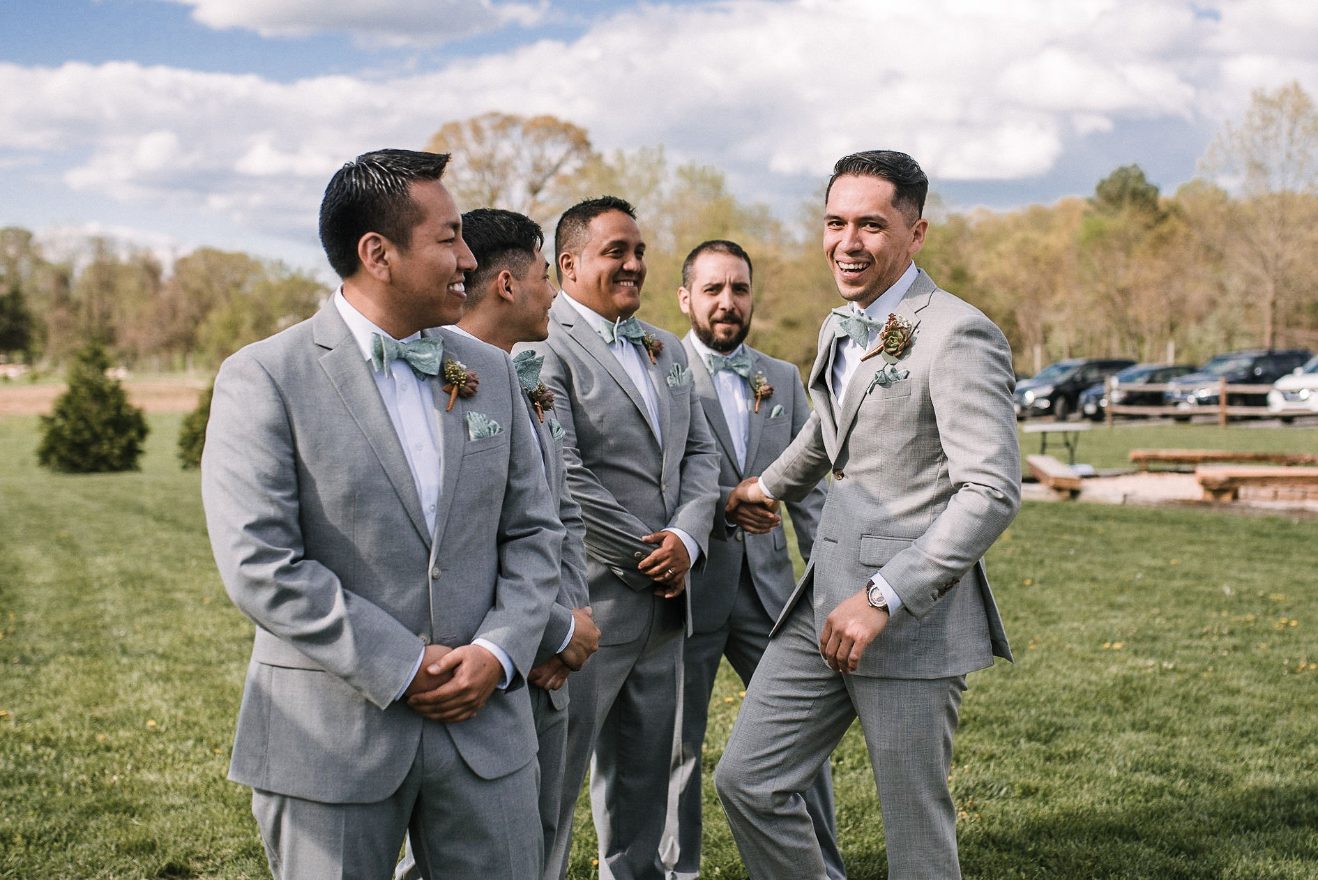 groom at the altar with groomsmen at the Faithbrooke Barn & Vineyards