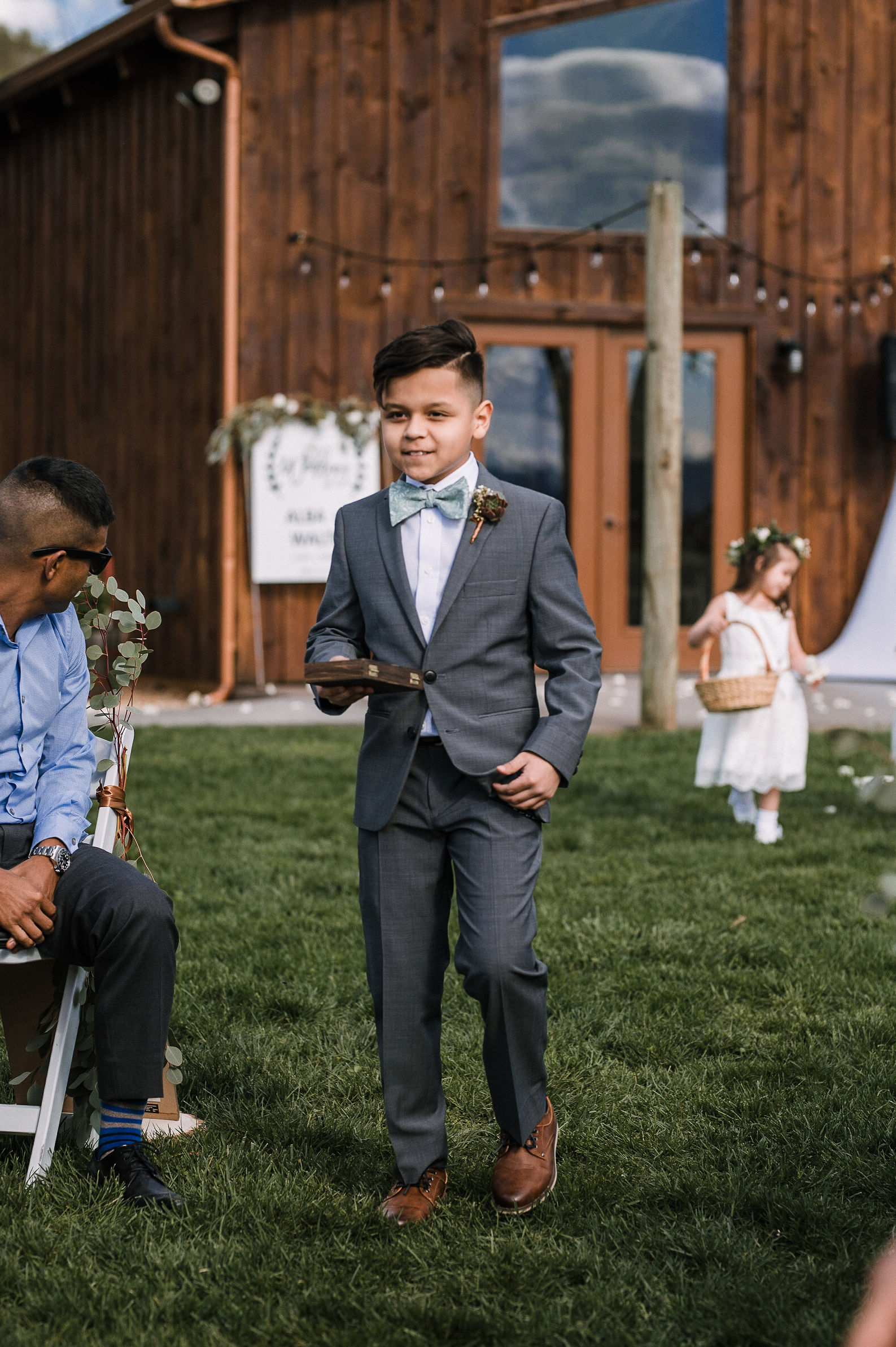 ring bearer walking down the aisle at the Faithbrooke Barn & Vineyards