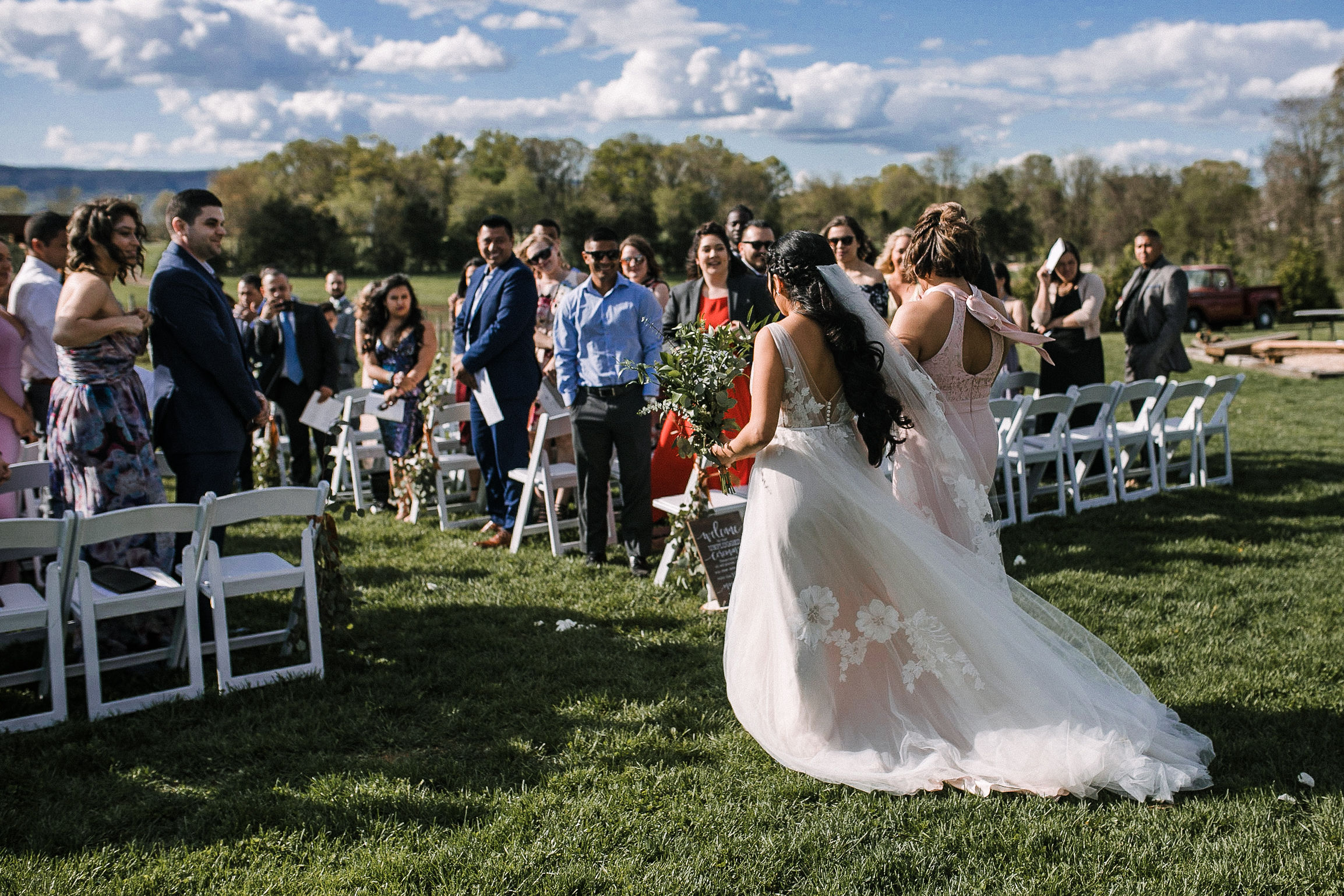 bride walking down the aisle with mother at the Faithbrooke Barn & Vineyards