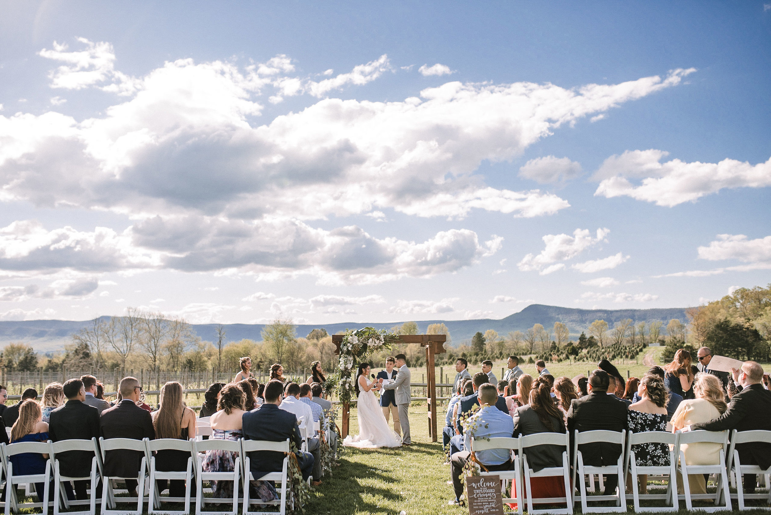 bride and groom saying vows at altar at the Faithbrooke Barn & Vineyards