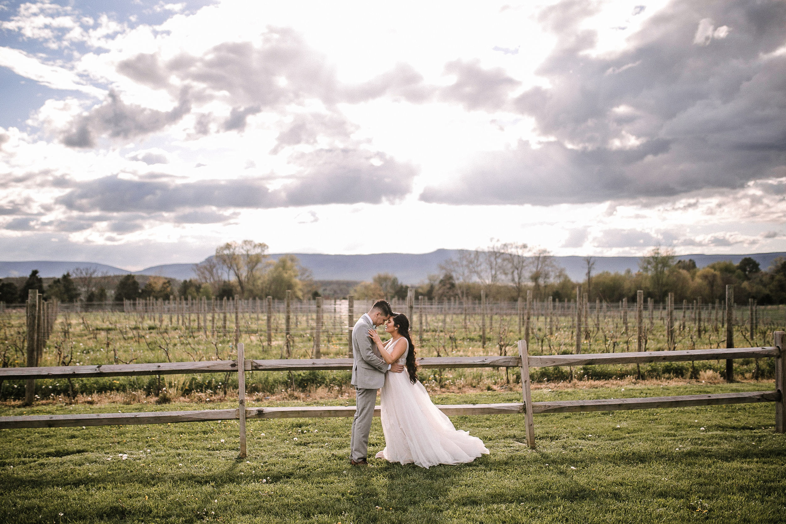 bride and groom embracing at the Faithbrooke Barn & Vineyards