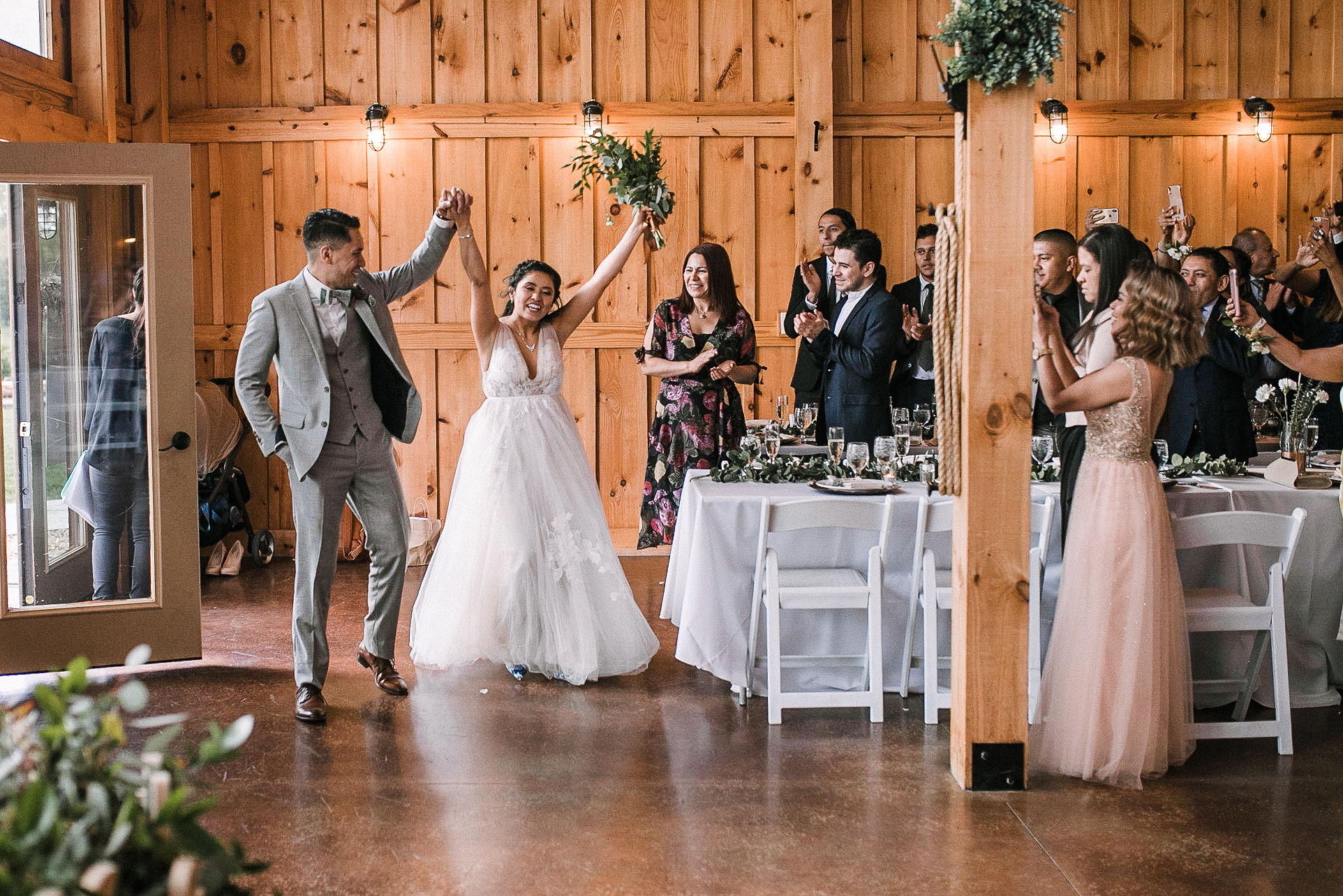 bride and groom entering reception at the Faithbrooke Barn & Vineyards