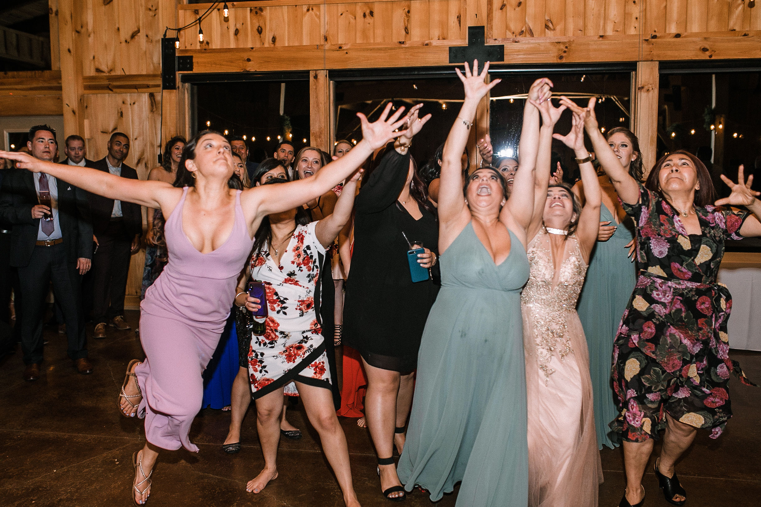guests trying to catch bouquet at the Faithbrooke Barn & Vineyards