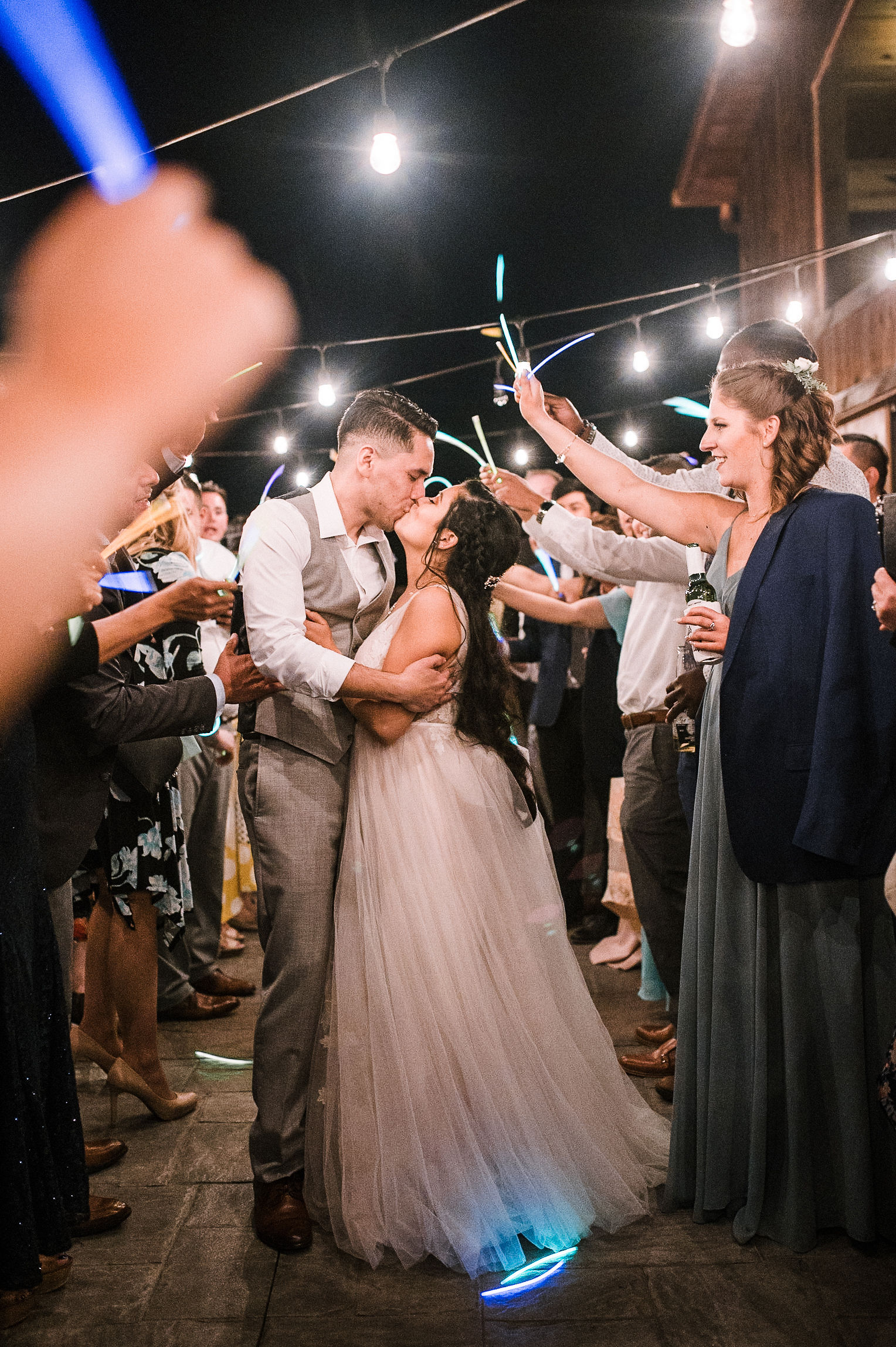 bride and groom kissing under glow sticks at the Faithbrooke Barn & Vineyards