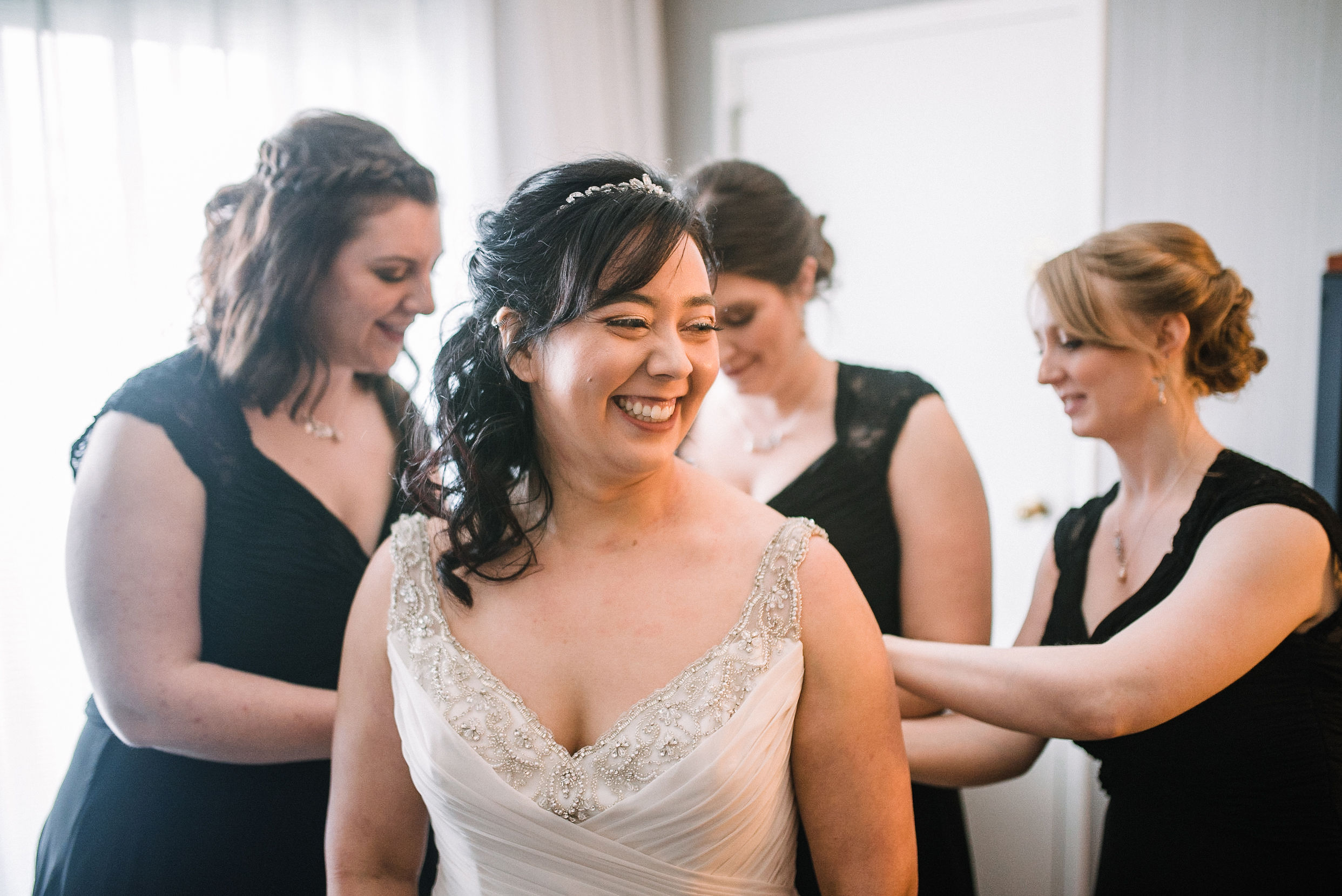 bride smiling as she gets ready at westfields golf club