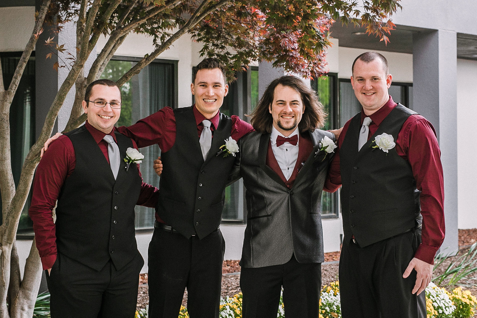 groom and groomsmen smiling at westfields golf club