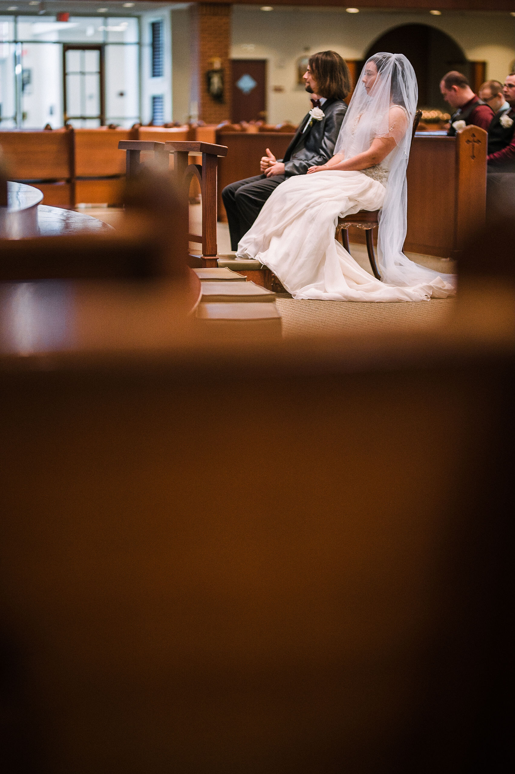 bride and groom during ceremony at all saints catholic church