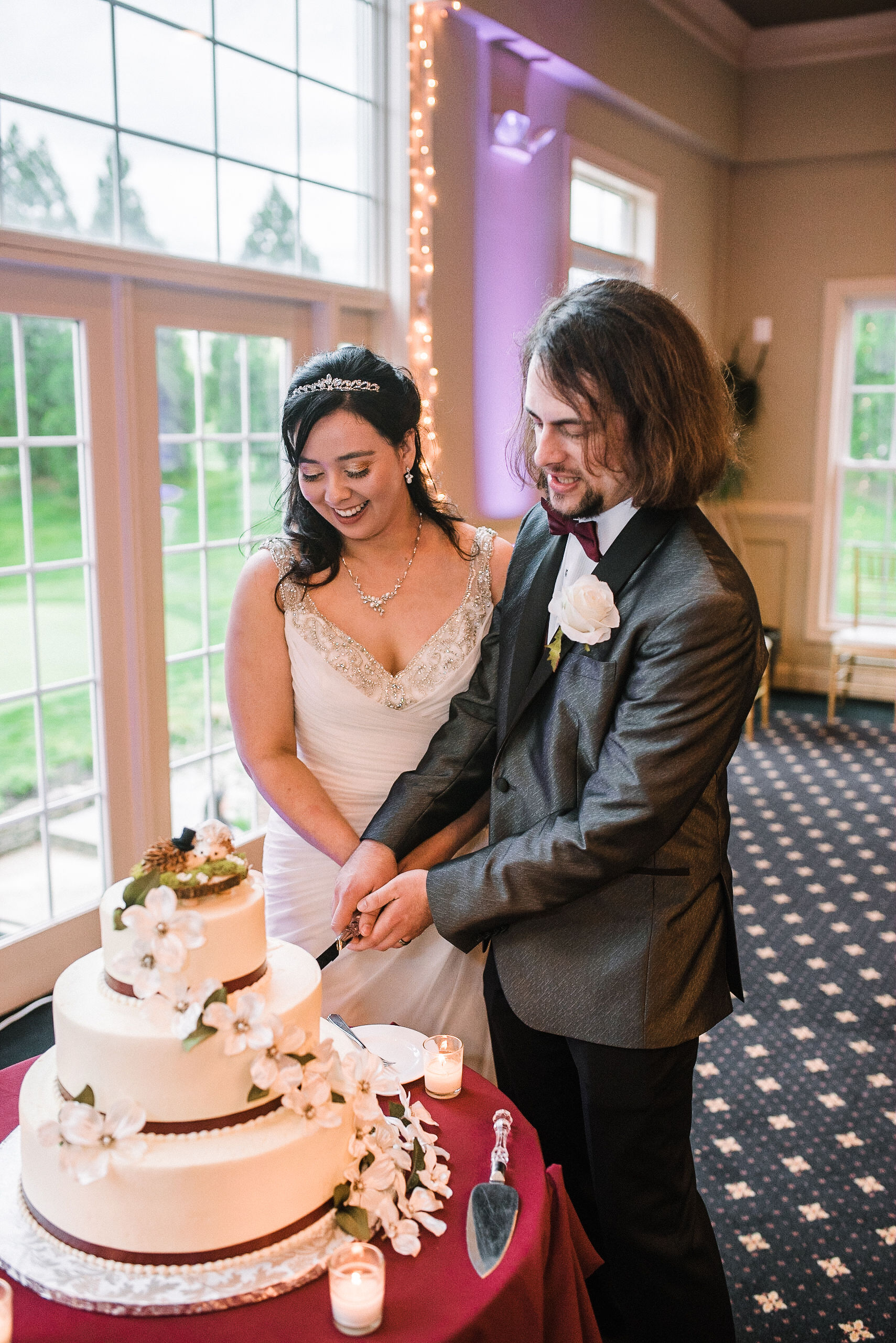 bride and groom cutting cake at westfields golf club