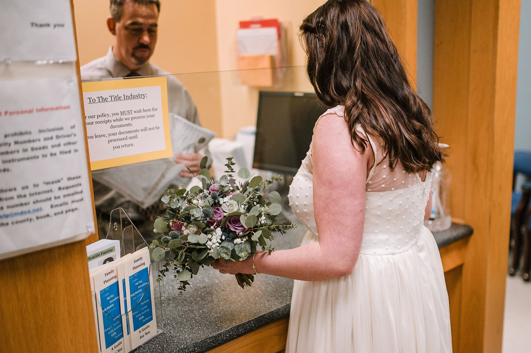 bride getting information at City Hall in Frederick, MD