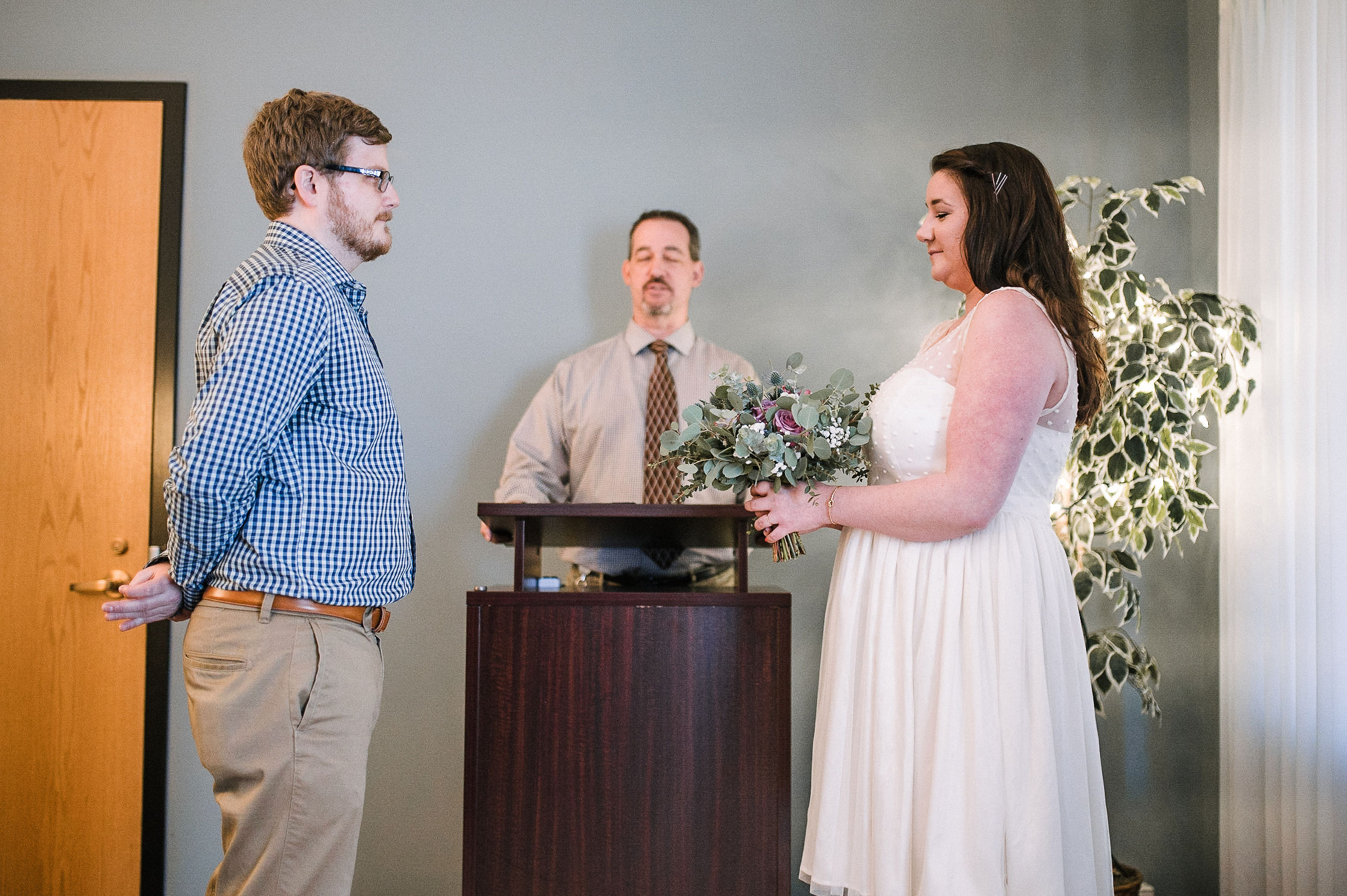 bride and groom exchanging vows at City Hall in Frederick, MD