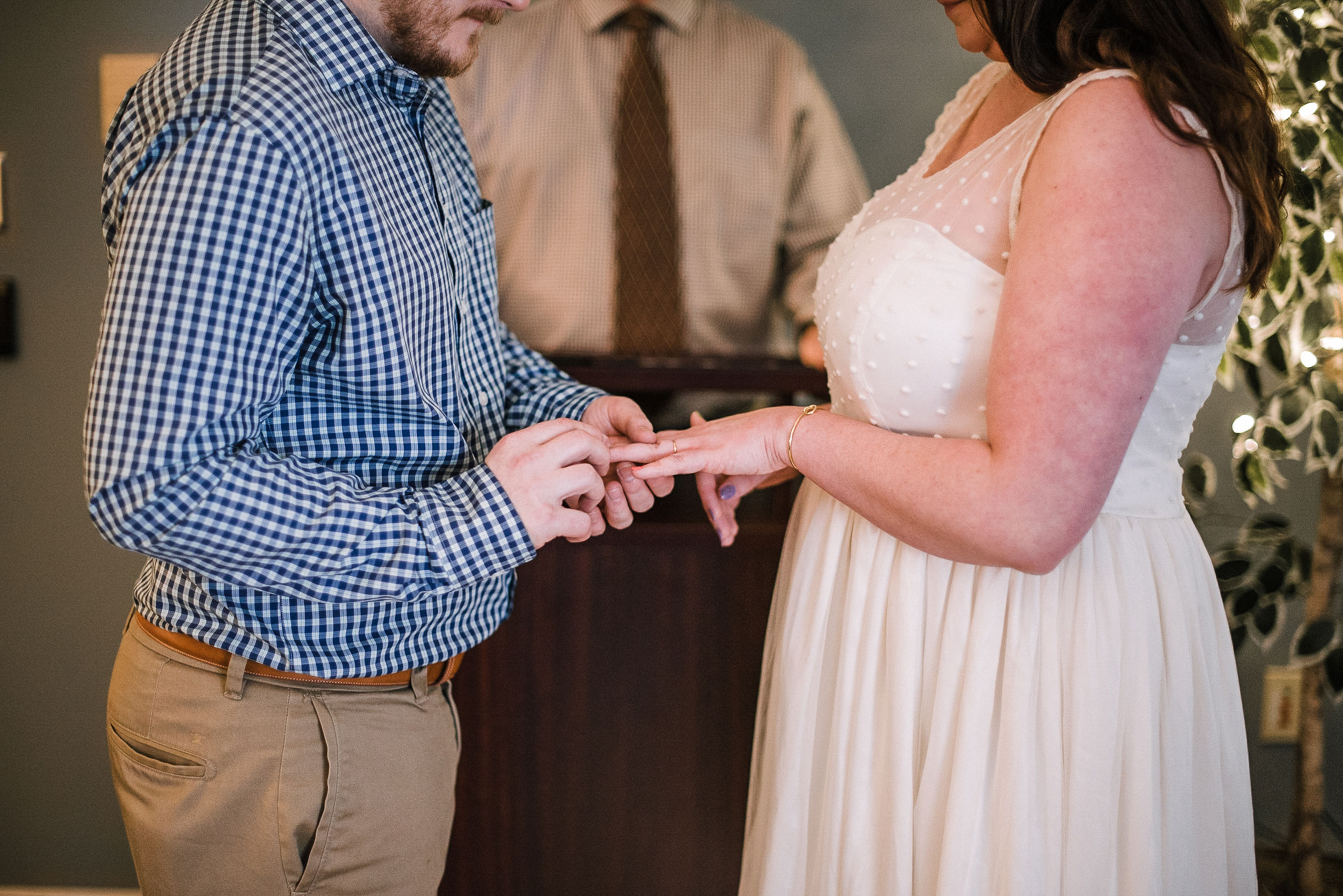 bride and groom exchanging rings at City Hall in Frederick, MD