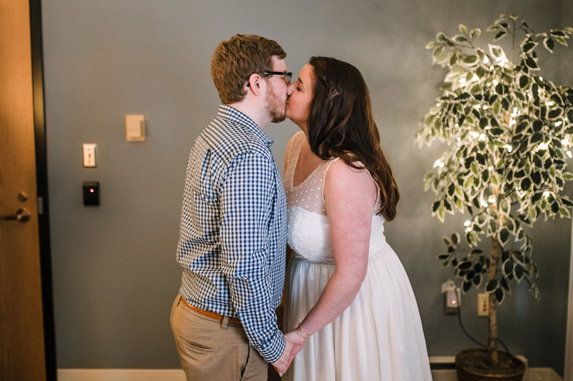 bride and groom kissing after getting married at City Hall in Frederick, MD