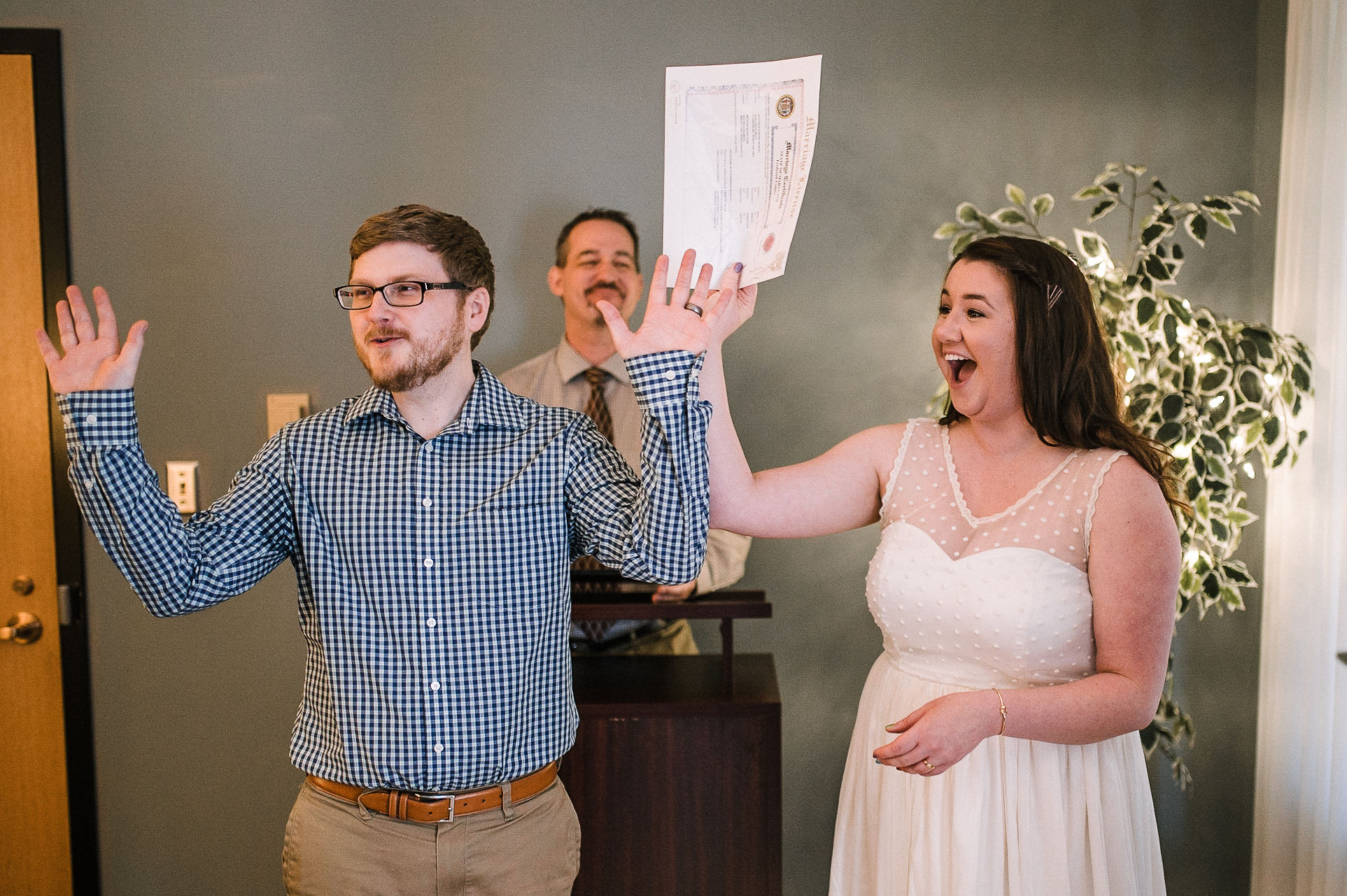 bride and groom officially get married at City Hall in Frederick, MD