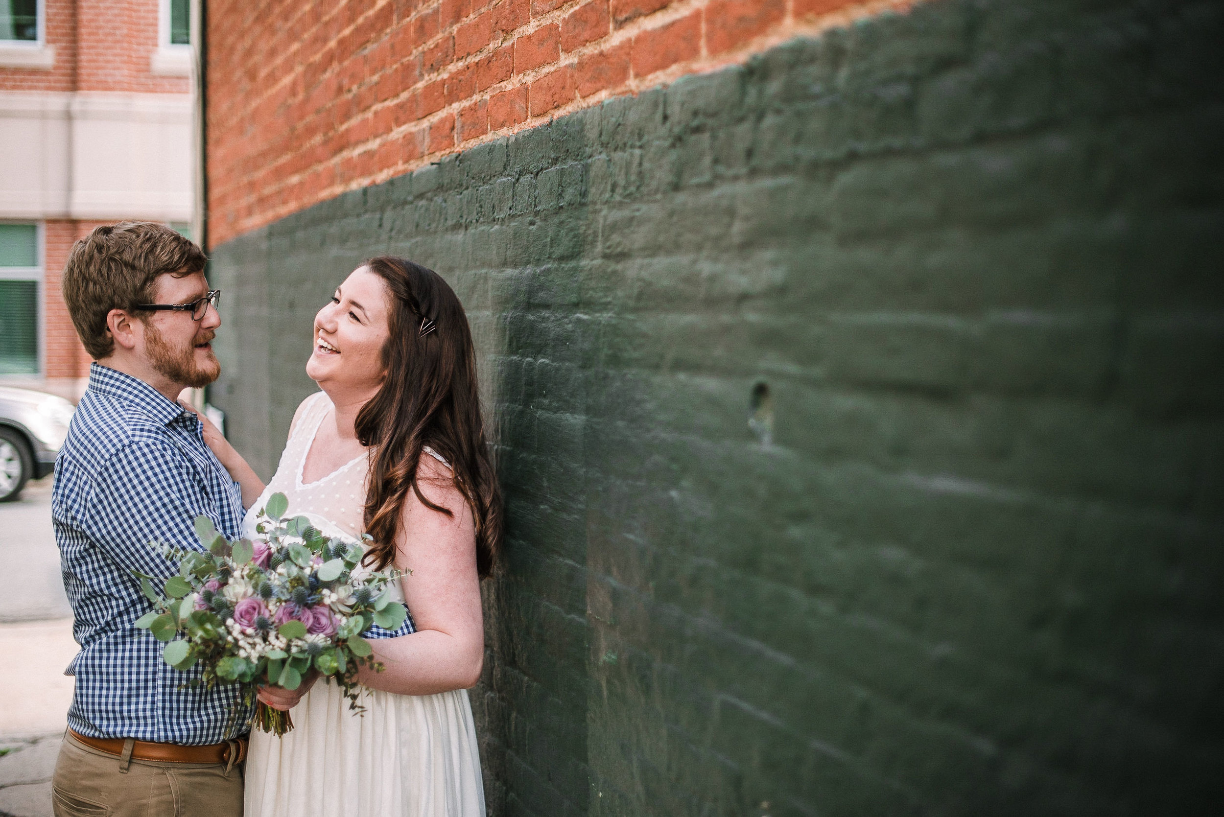 bride and groom laughing at Frederick, Maryland
