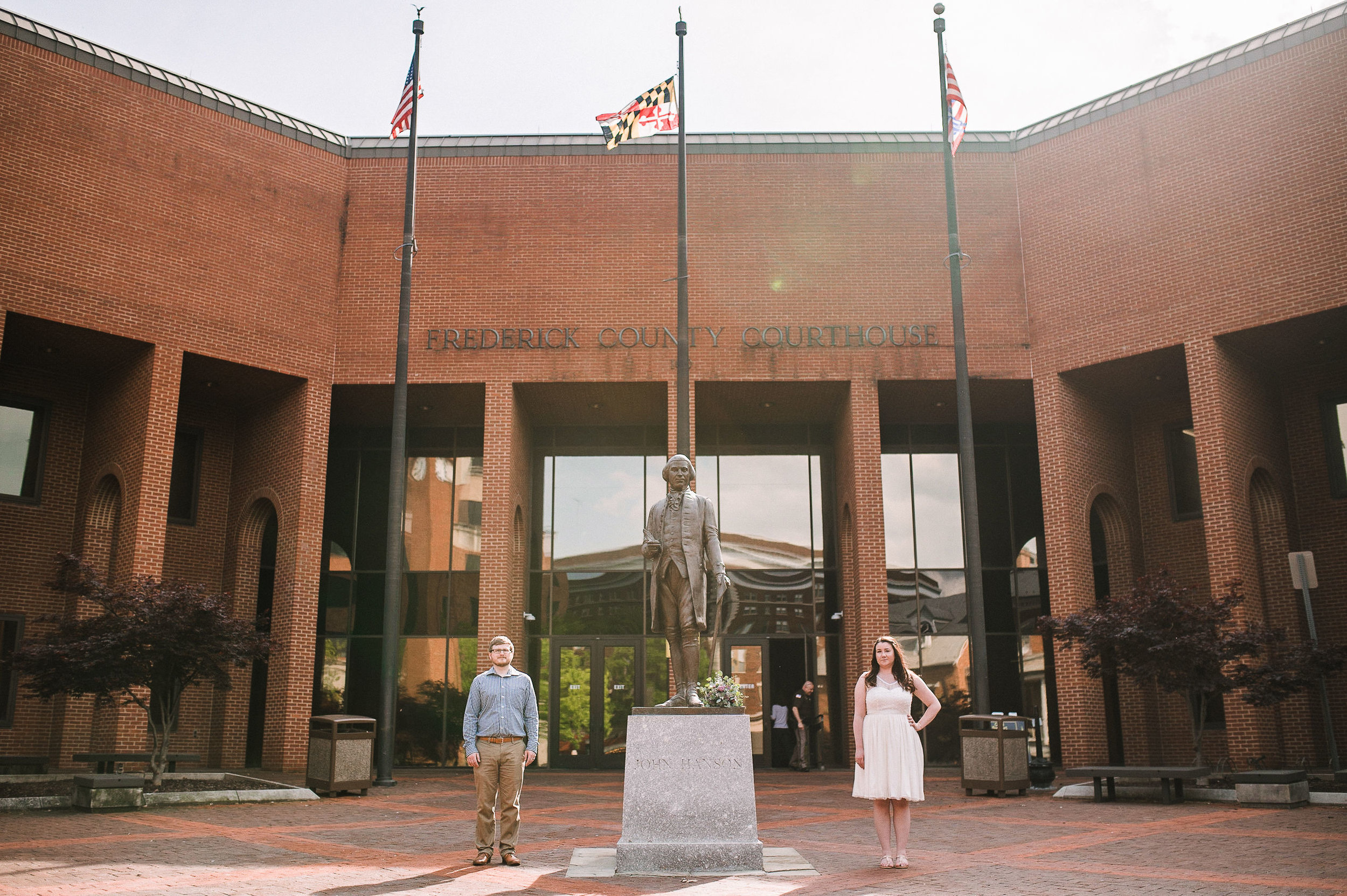 bride and groom outside of city hall  at Frederick, Maryland