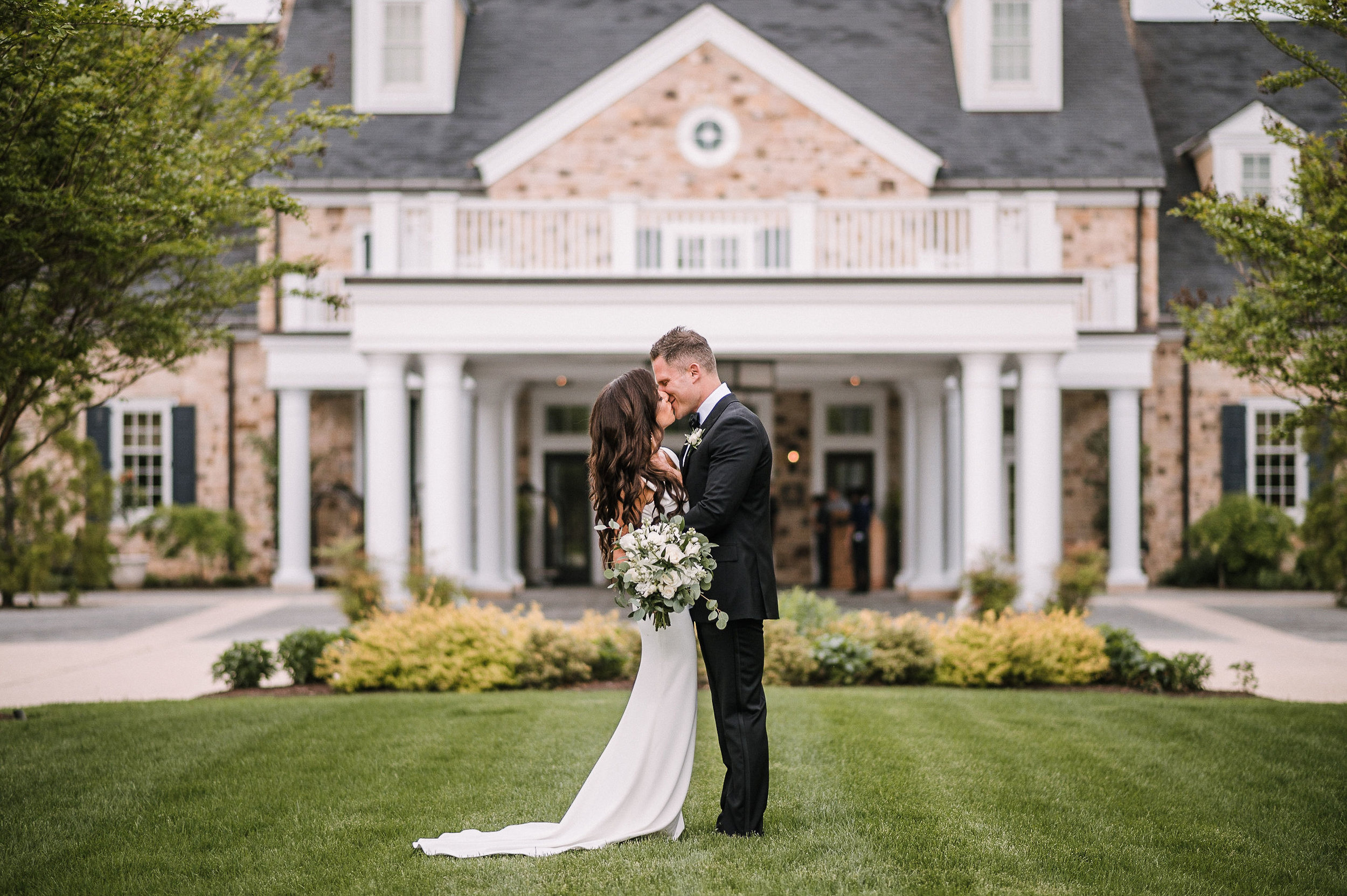 bride and groom kissing at The Salamander Resort