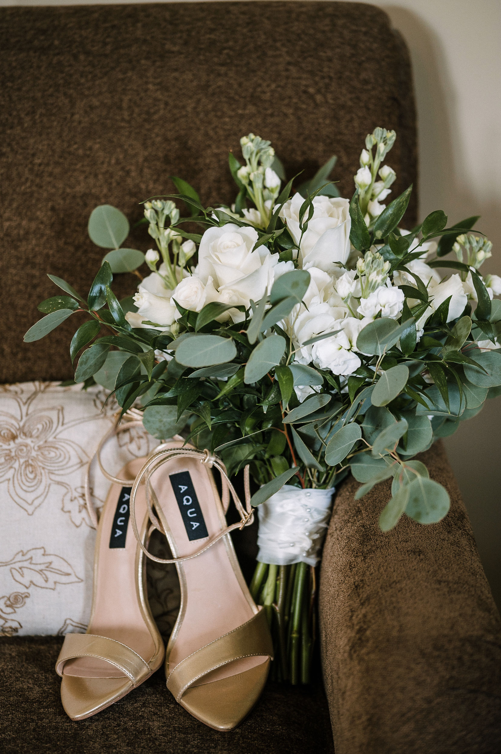 detail shot of bride's shoes and bouquet at The Salamander Resort
