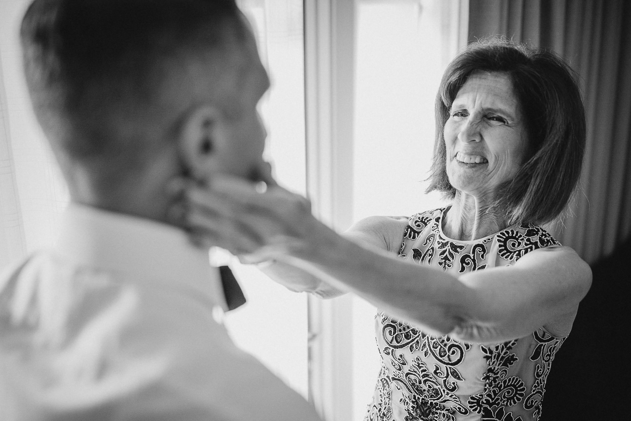 mother of the groom helping groom get ready at The Salamander Resort