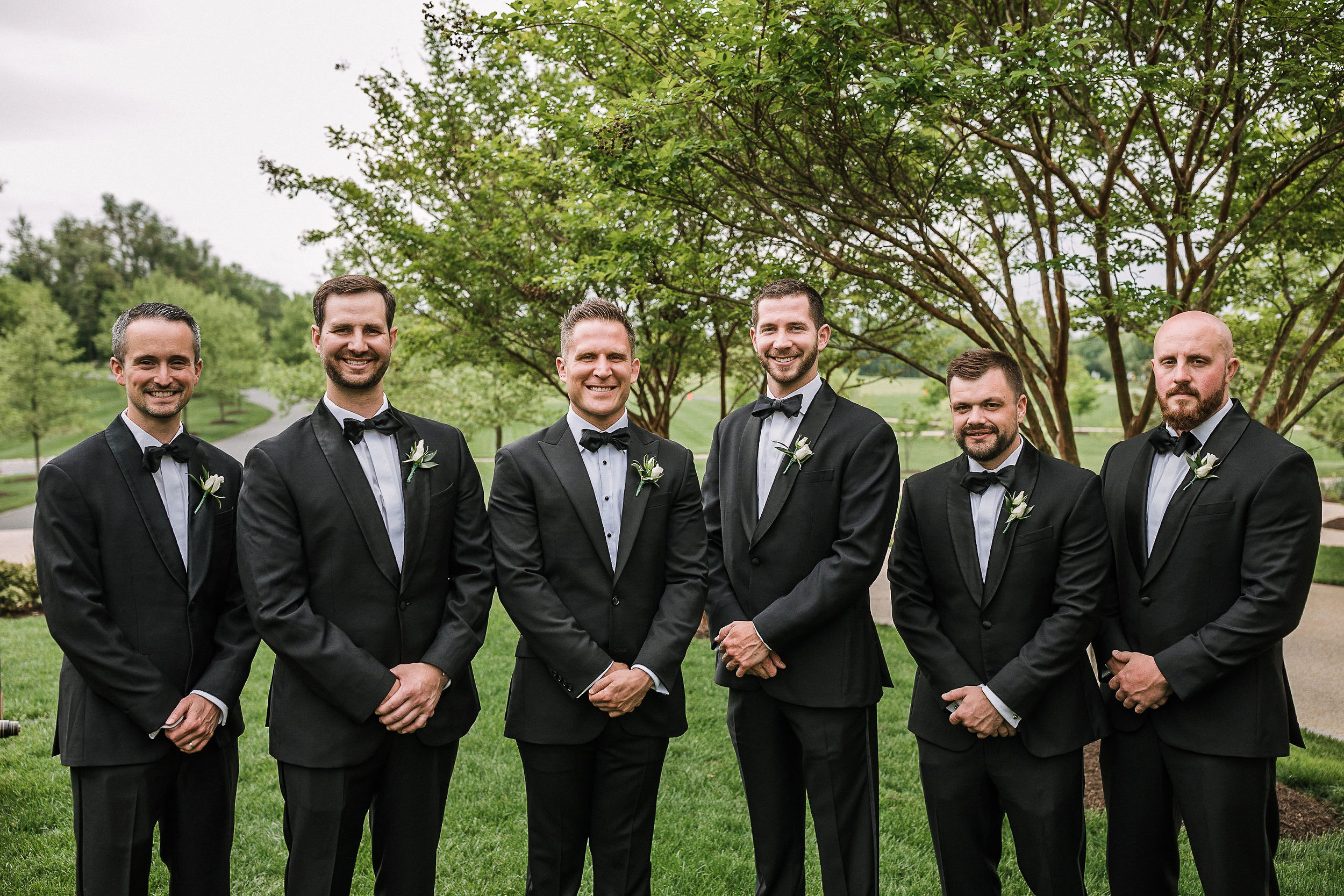 groom and groomsmen smiling at The Salamander Resort